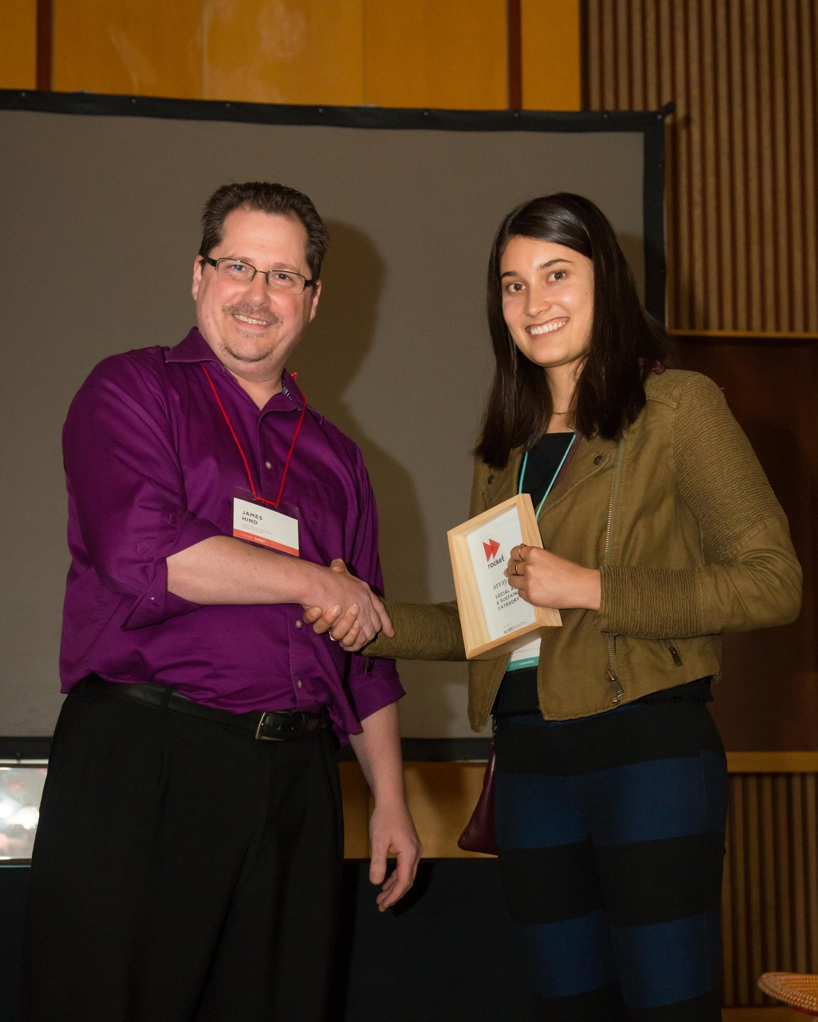 Meagan Louie accepting the Array Social Awareness & Sustainability Award from James Hind of Array.