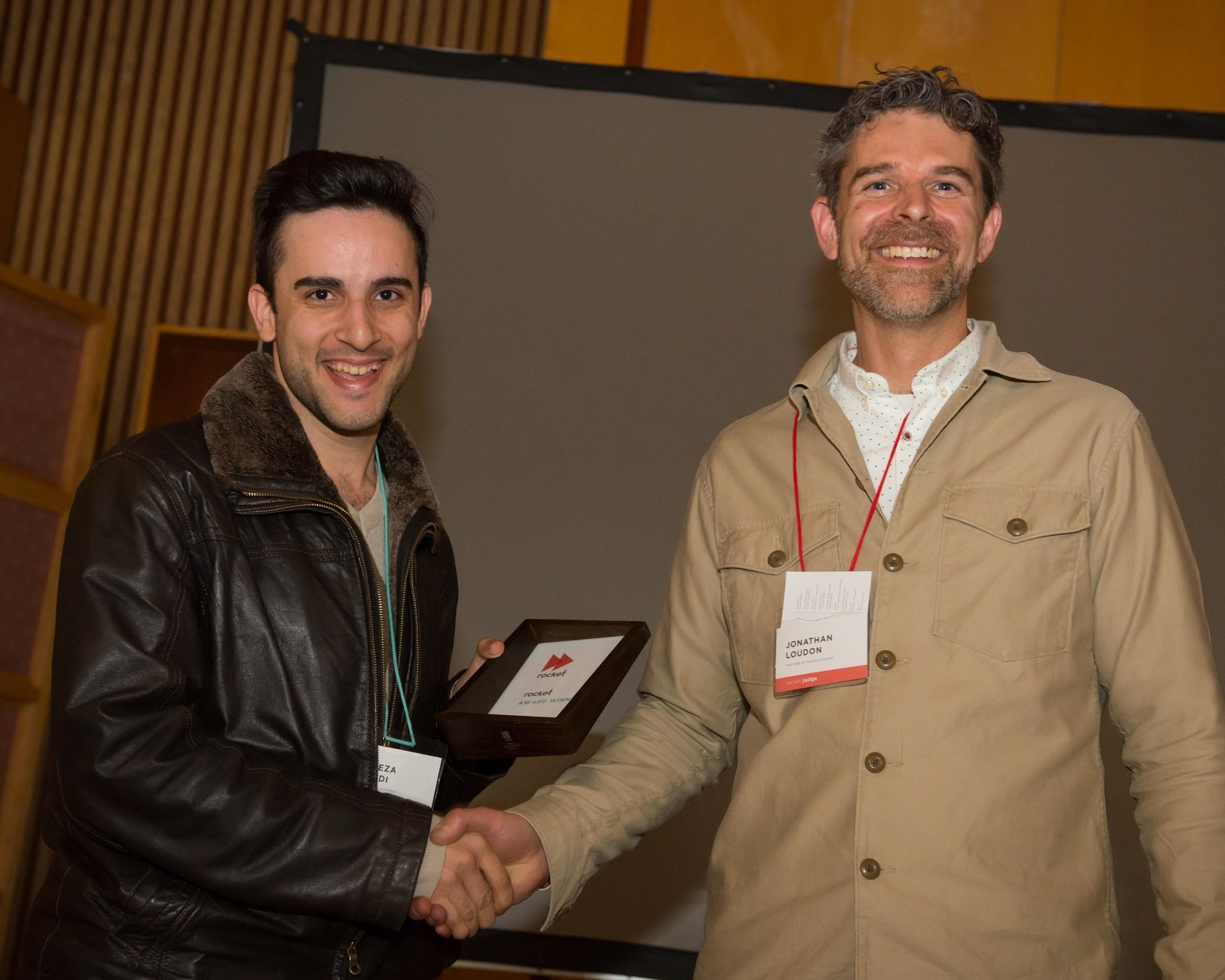 Alireza Saeedi accepting the Rocket Award from ACIDO President Jonathan Loudon.