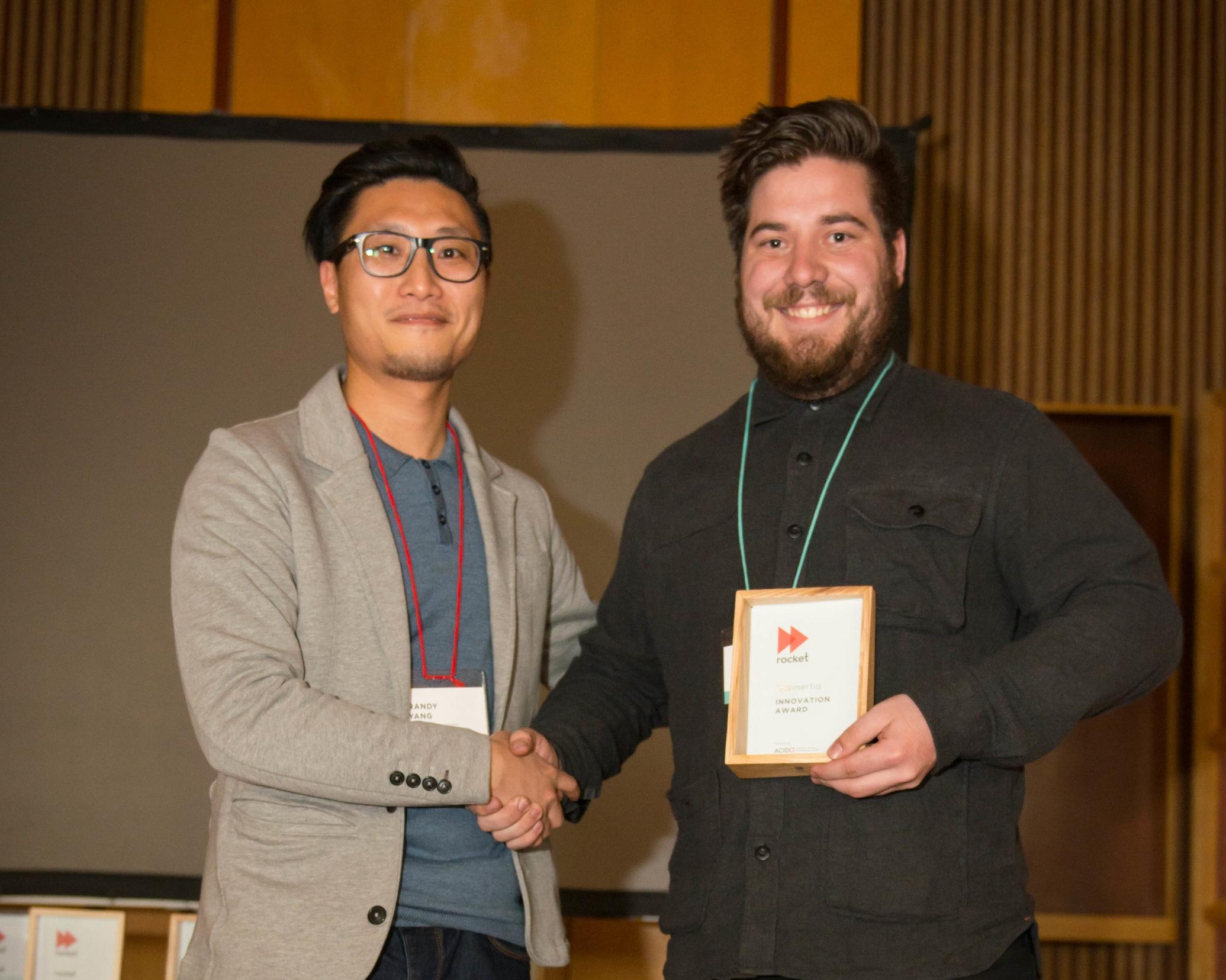 Jack Morris accepting the Inertia Innovation Award from Randy Yang at Inertia.
