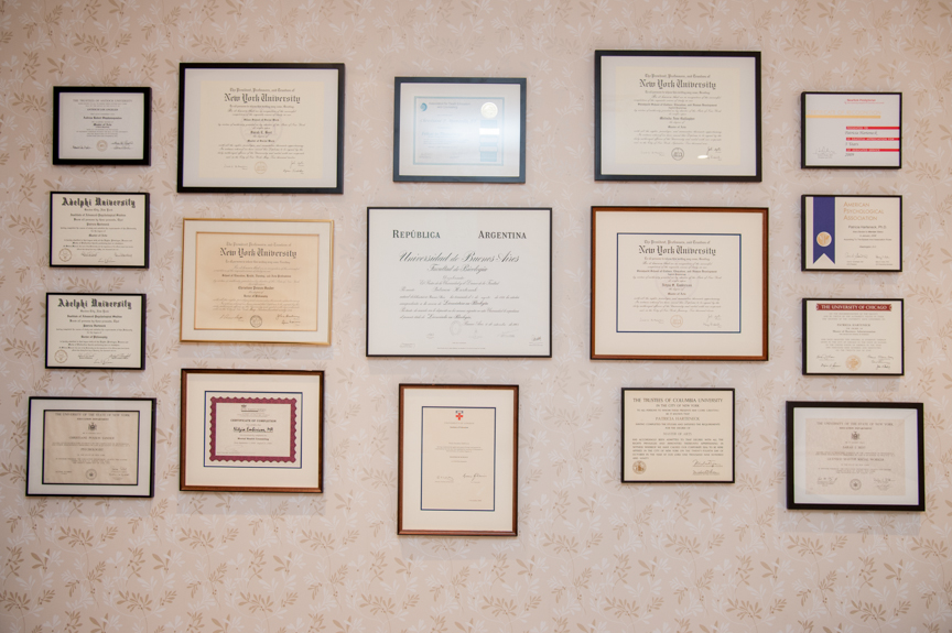 Our wall of diplomas