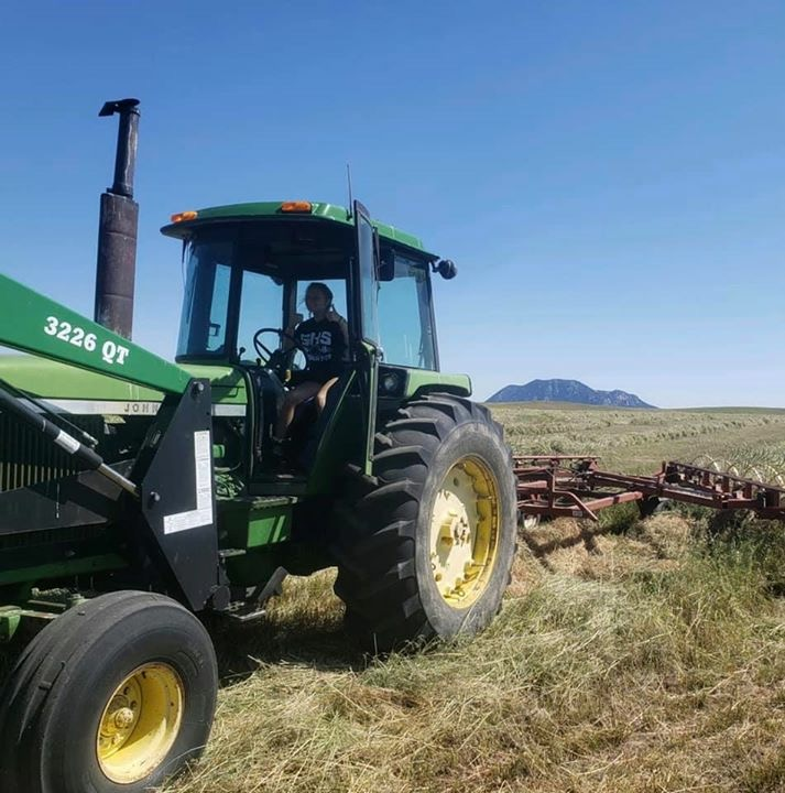 Tennessee girl working in the Big Sky Country - what family does! Rayley (16 yrs) pitching in to help in the hay.