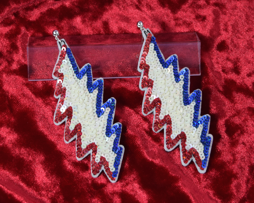 "Grateful Dead Earrings 2 x 4 inches - Sequins - $130  Total time: ~6 hours  ""I want a pair of Grateful Dead lightning bolts, in a traditional style"""