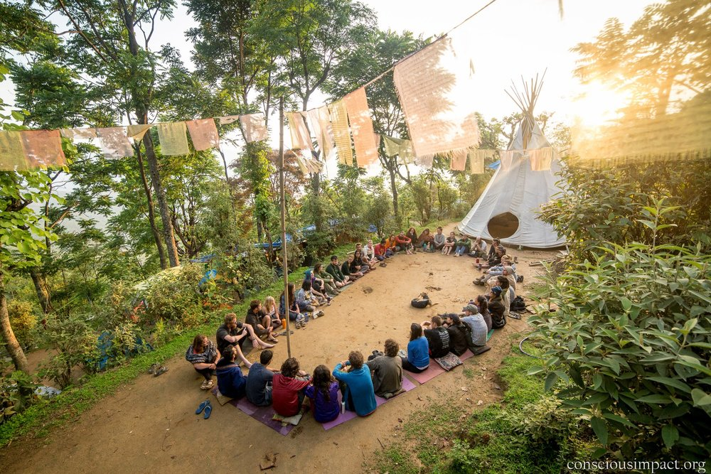 Conscious Impact volunteers gather to share gratitude at our camp in Takure.