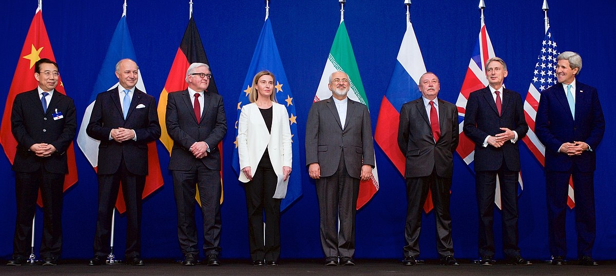The representatives of the P5+1, Iran, and the EU smile as they complete the JCPOA