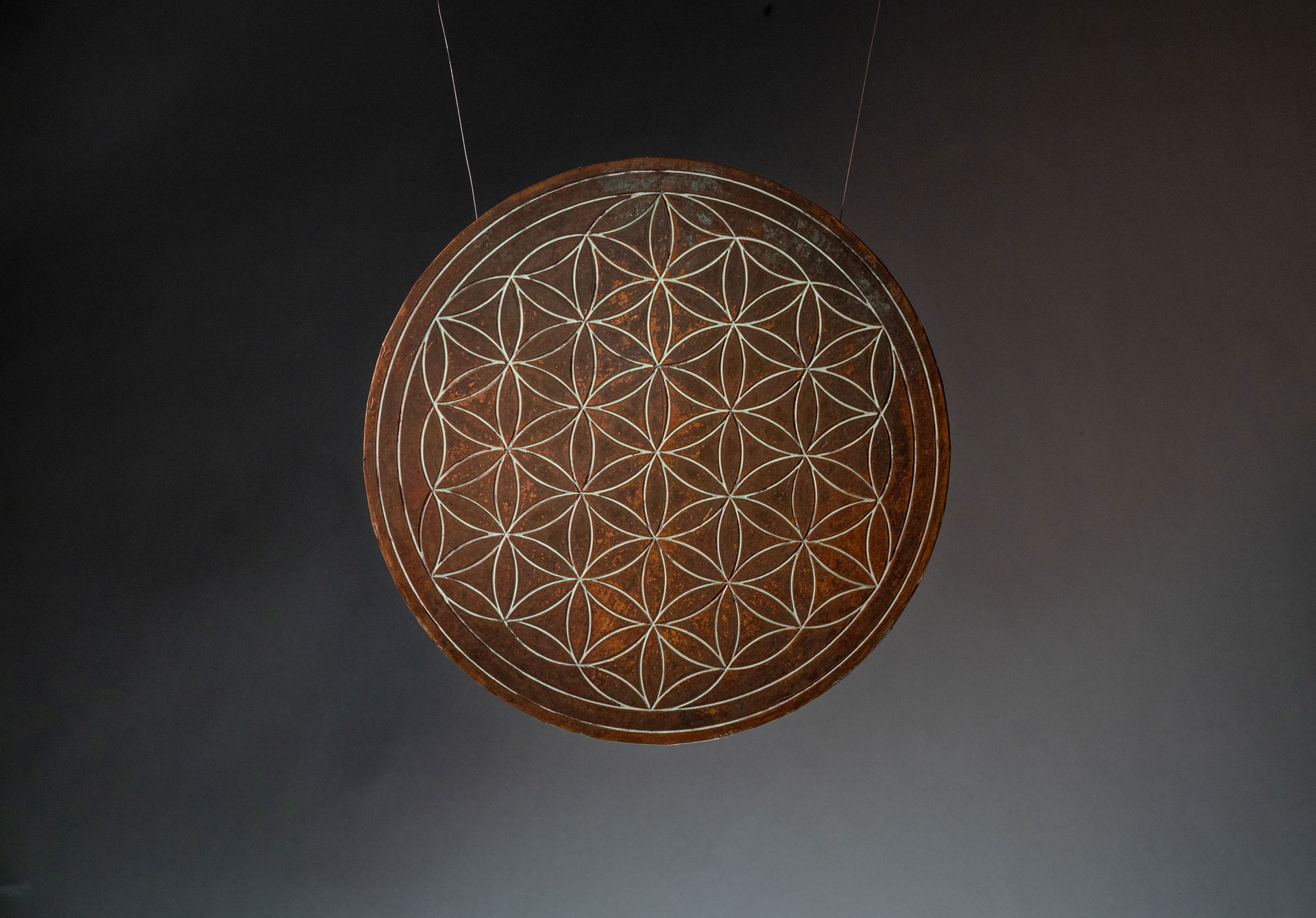 FLOWER OF LIFE - It's perfect form and proportion emits a harmonious elemental flow. Interpreted infinitely throughout the ages from a deeply spiritual aid for meditation to a visual expression of the connections of life that run through all sentient beings. MATERIAL: Copper