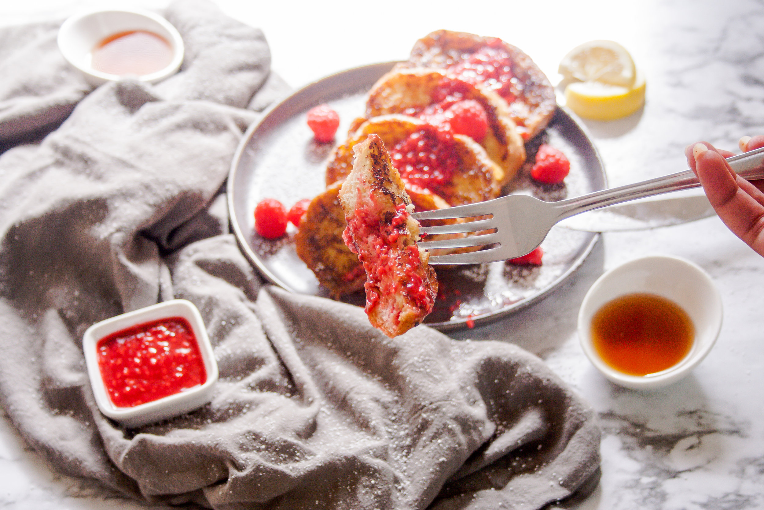 Eggnog French Toast with Bourbon Raspberry Sauce