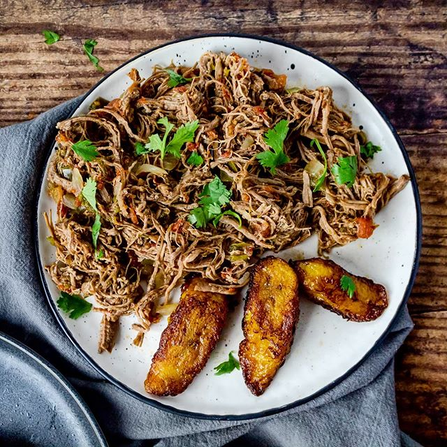 "Happy June, foodies!! 💛 It's my birthday month and I'm kicking it off with this bomb slow cooked Ropa Vieja recipe! Ropa Vieja, meaning ""old clothes"" in Spanish is the national dish of Cuba and personally, one of my favorite stewed beef recipes. I like it best served with rice, beans and plantains or even on top of some fried tostones for a quick snack! Check out the recipe link in my bio! ☝️😌"