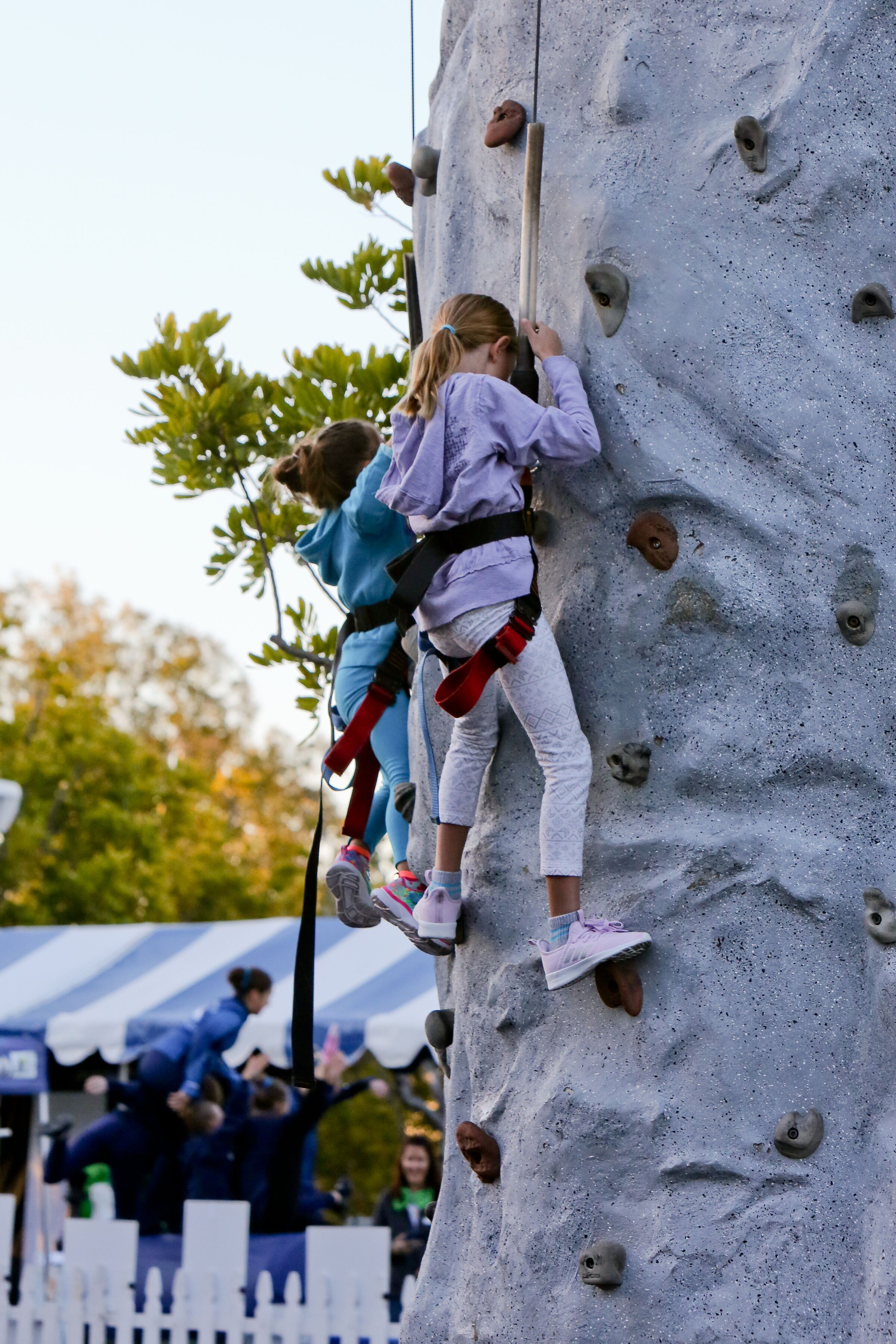 girls climbing rock wall.jpeg