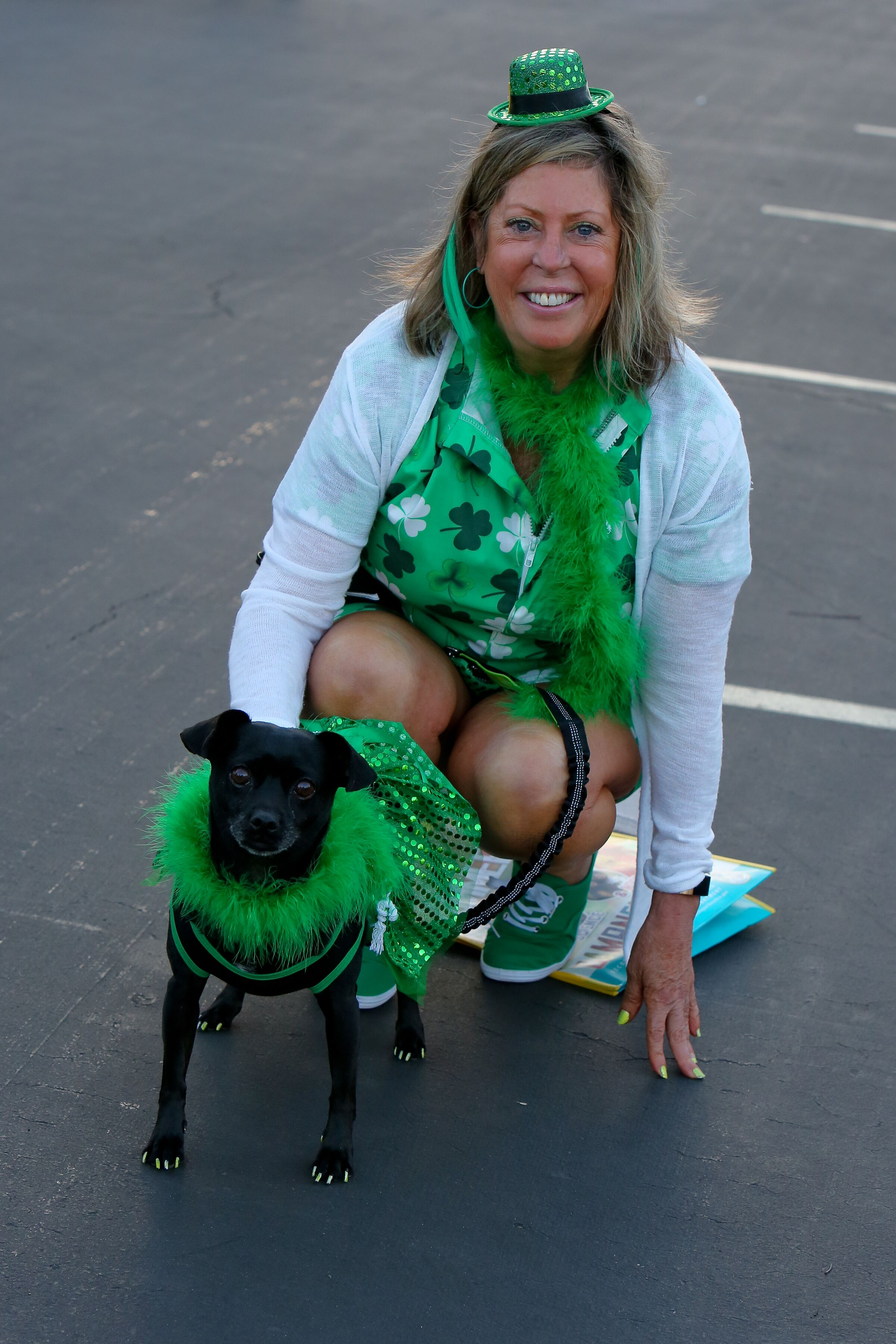 lady and doggie dressed in st. patty's oostume posing.jpeg