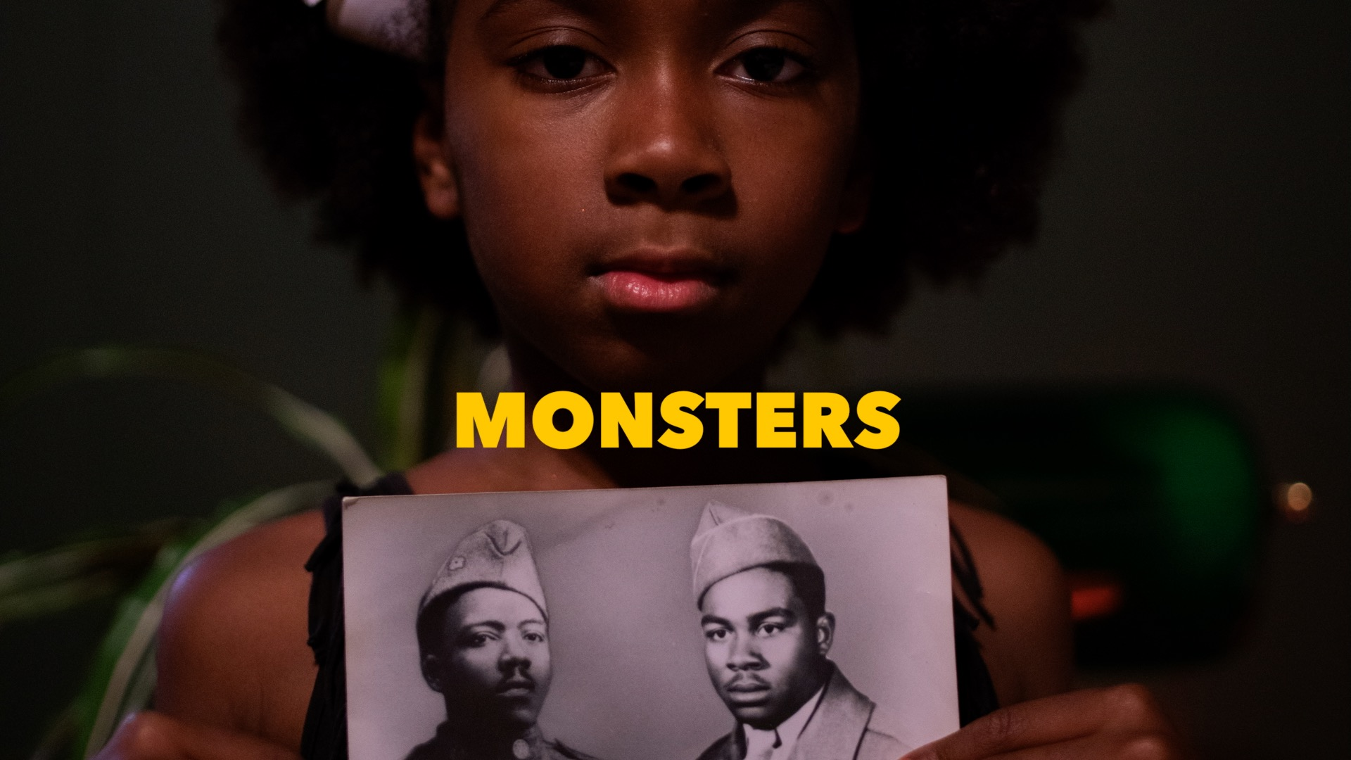 Mahal Gilbert, screenshot of Monsters Music Video, Directed by Omar De Leon, music created by Real J. Wallace and Daniel Koestner aka Real j & DNYKAY