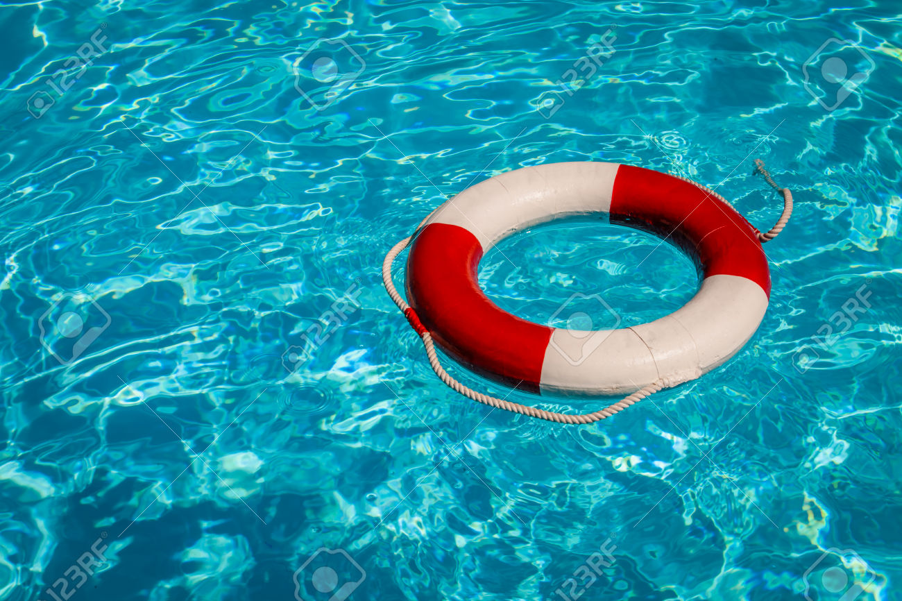 30848057-A-close-up-shot-of-a-life-guards-red-and-white-rescue-ring-buoy-floating-in-a-pool-Stock-Photo.jpg