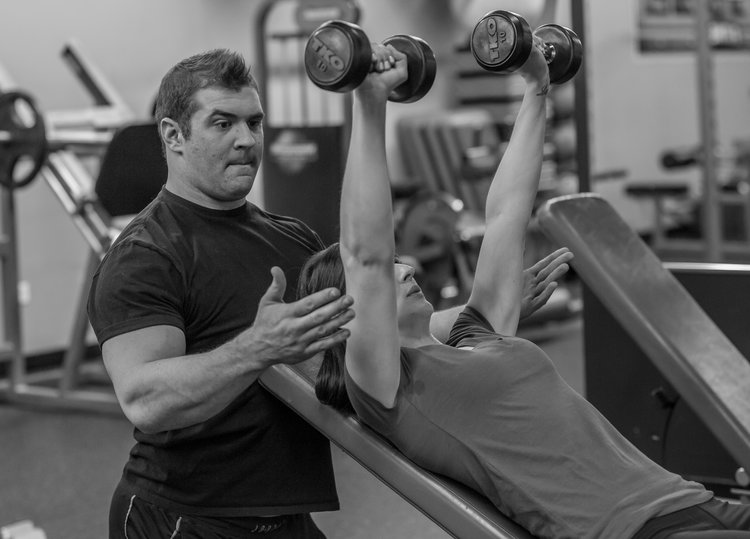 """Custom programs to fit your needs - """"Drake is a fantastic personal trainer, and this is a great deal. I, myself am a personal trainer and his workouts and programs are well planned and thought out. He challenges you while taking into account any issues you might have. The gym is set up well, the other trainers work great together, it's a nice, welcoming atmosphere. I would definitely recommend Drake and plan on returning to him as a trainer in the future!""""-Dina S. · (Groupon)View Packages ➝"""