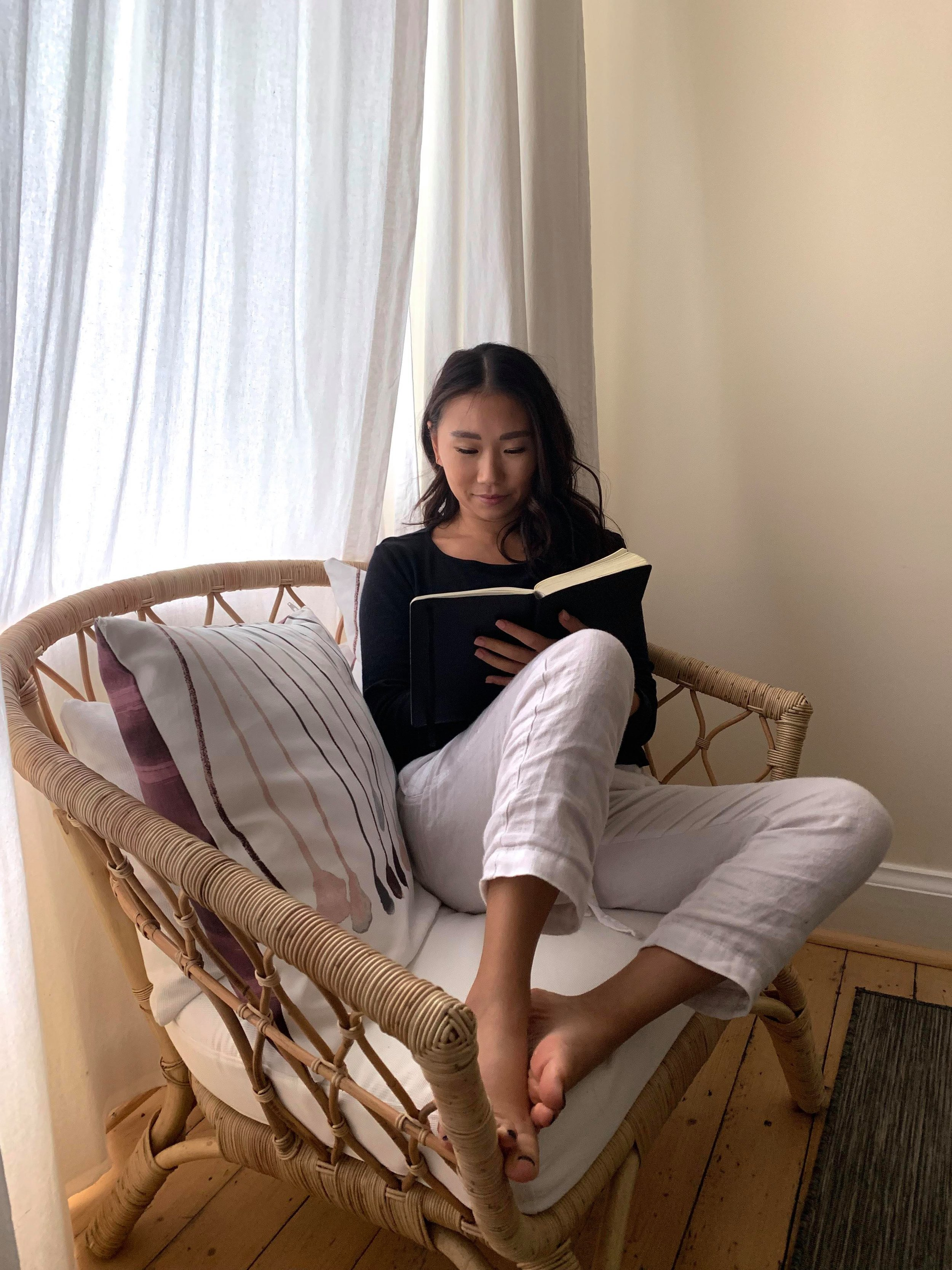 just a girl doing her thing, earning abundantly from a wicker chair. -