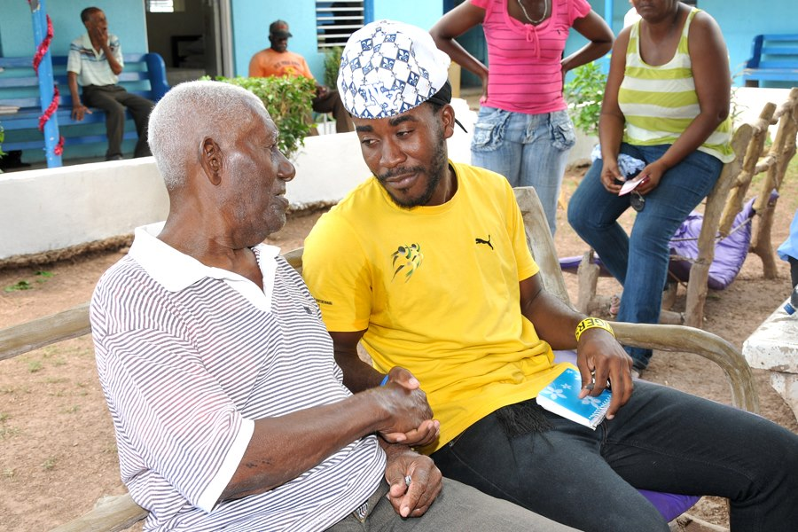 Neville Charlton  interacts with a resident at  The Kingston Golden Age Home