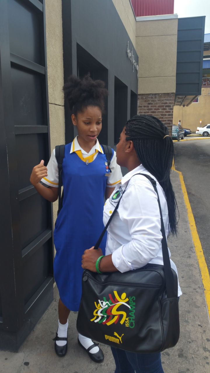 Tianna Thompson interacts with President of Youths Inspiring Positive Change Ja Samantha Miller