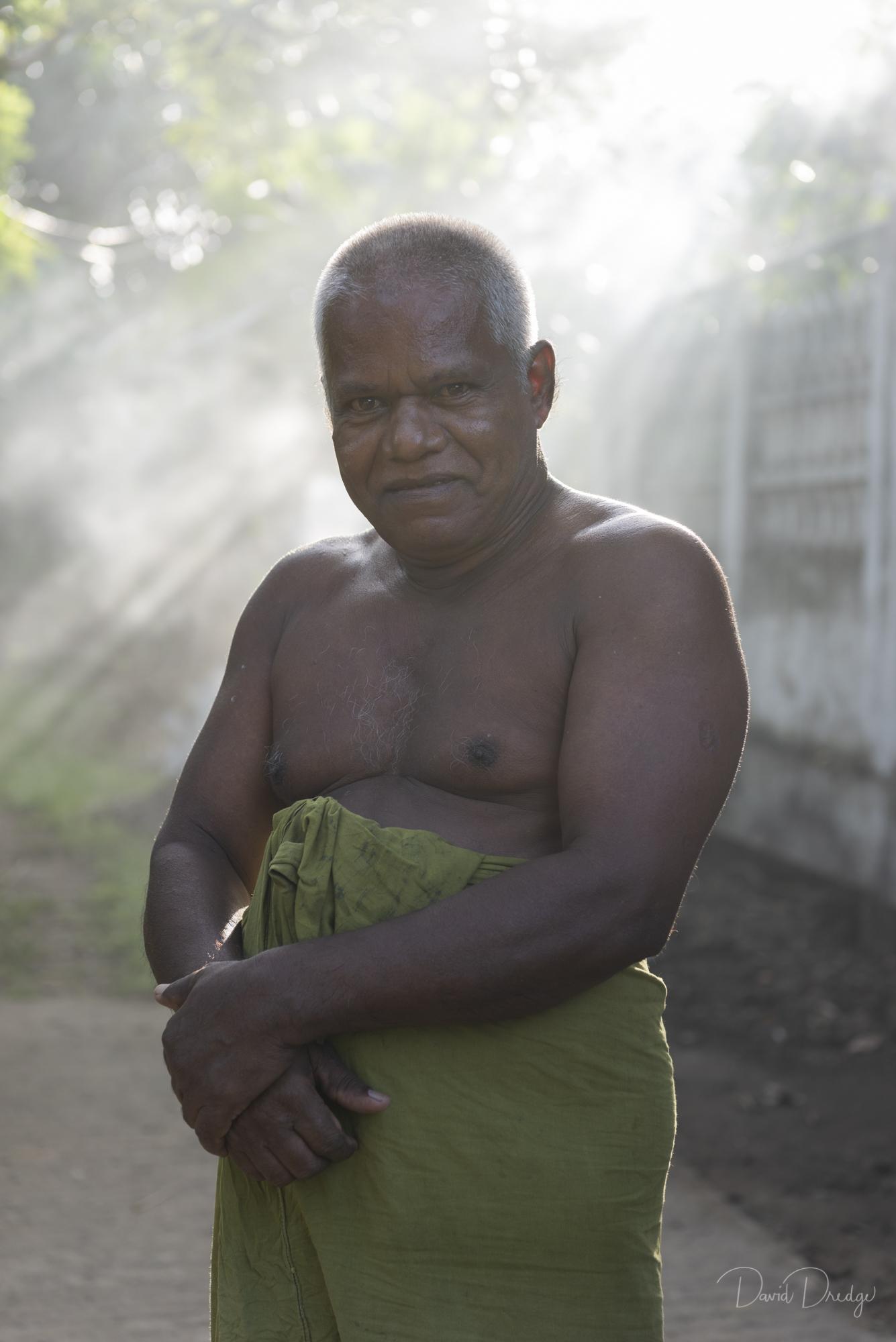 elderly Sri Lankan man wearing lungi