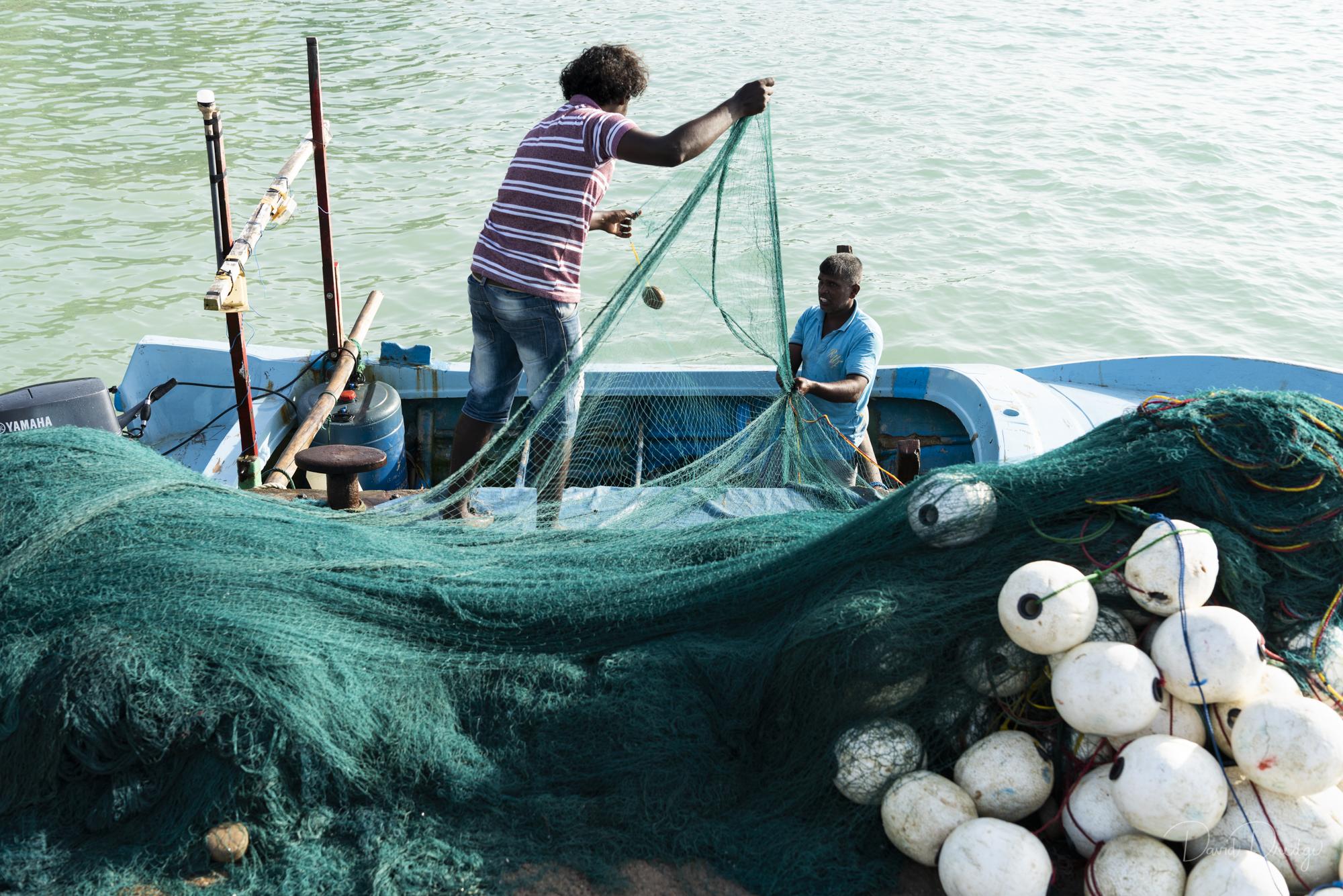 fishermen with fishing net