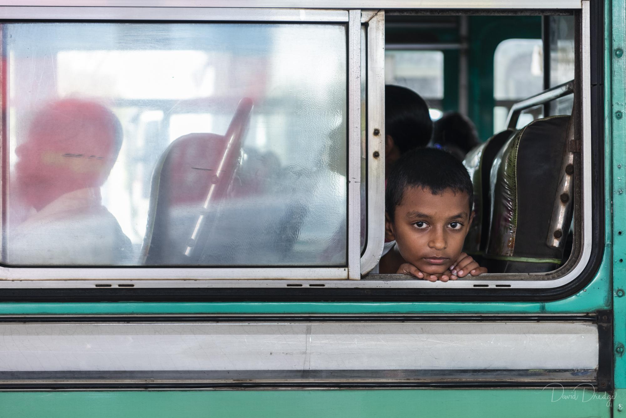 boy at bus window Galle