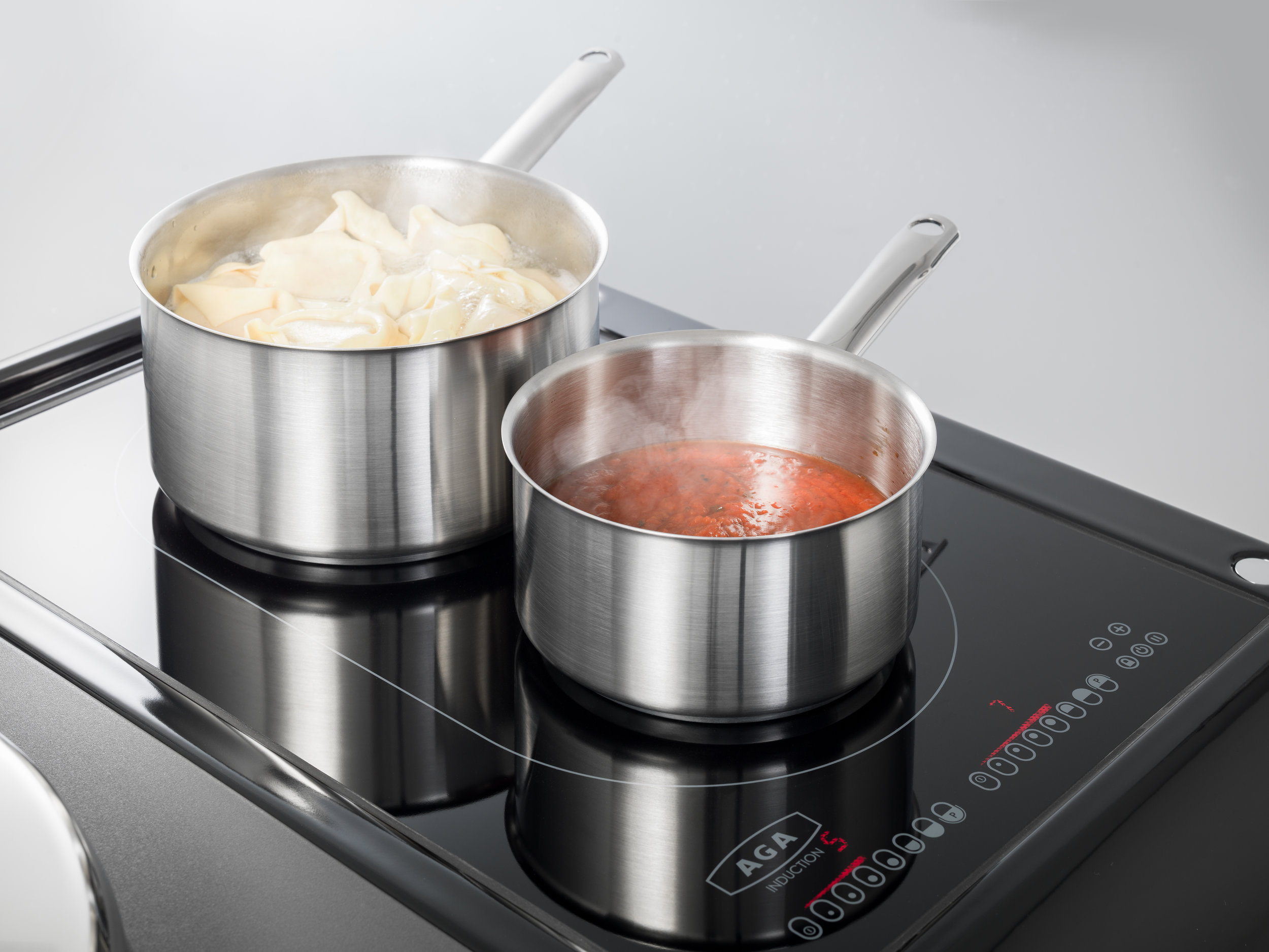 Induction Hotplate - This new AGA induction hotplate features a two-zone large pan area suitable for two pans, or an induction suitable with a griddle plate, fish kettle or other large cookware.Low temperature function include: One level for defrosting or melting (44 °C), Level for warming up and keeping warm (70 °C), Option: third warming level for simmering (94 °C)Automatic functions include: Boil detection with water, Heating up to a frying temperature,Time functions, Keep simmering or re-boil powerfully, Boil dry detection, Permanent pot detection, and aBridge/booster function.