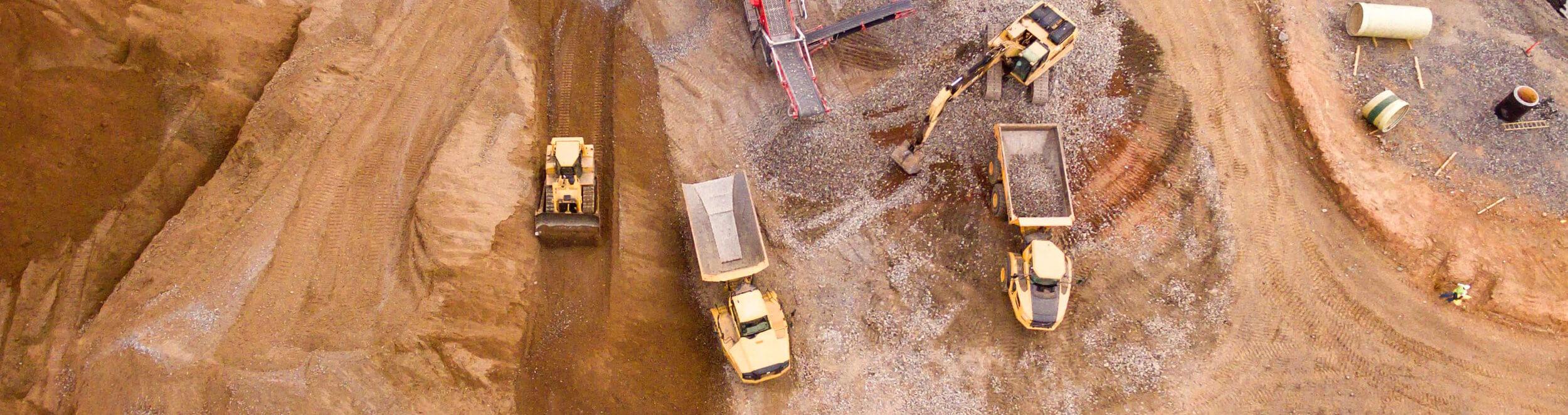 Quarry with excavators and dump trucks