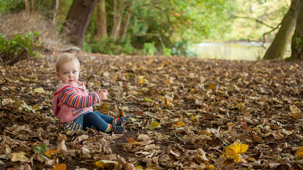This young lady is adorable but doesn't the stunning colour of the autumnal leaves provide a beautiful background?