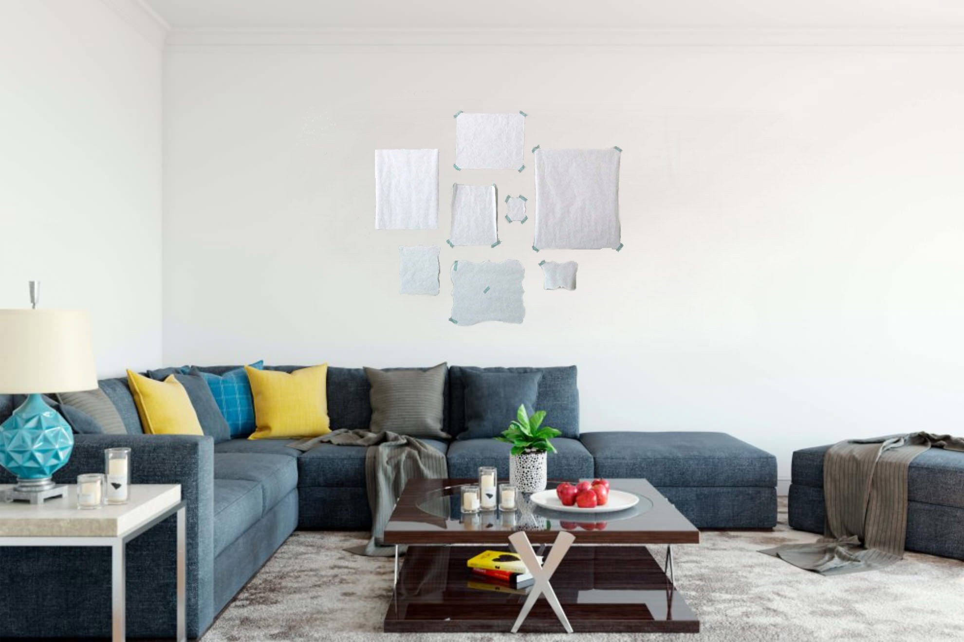Using pieces of paper to make a template can be really handy when planning out a wall gallery