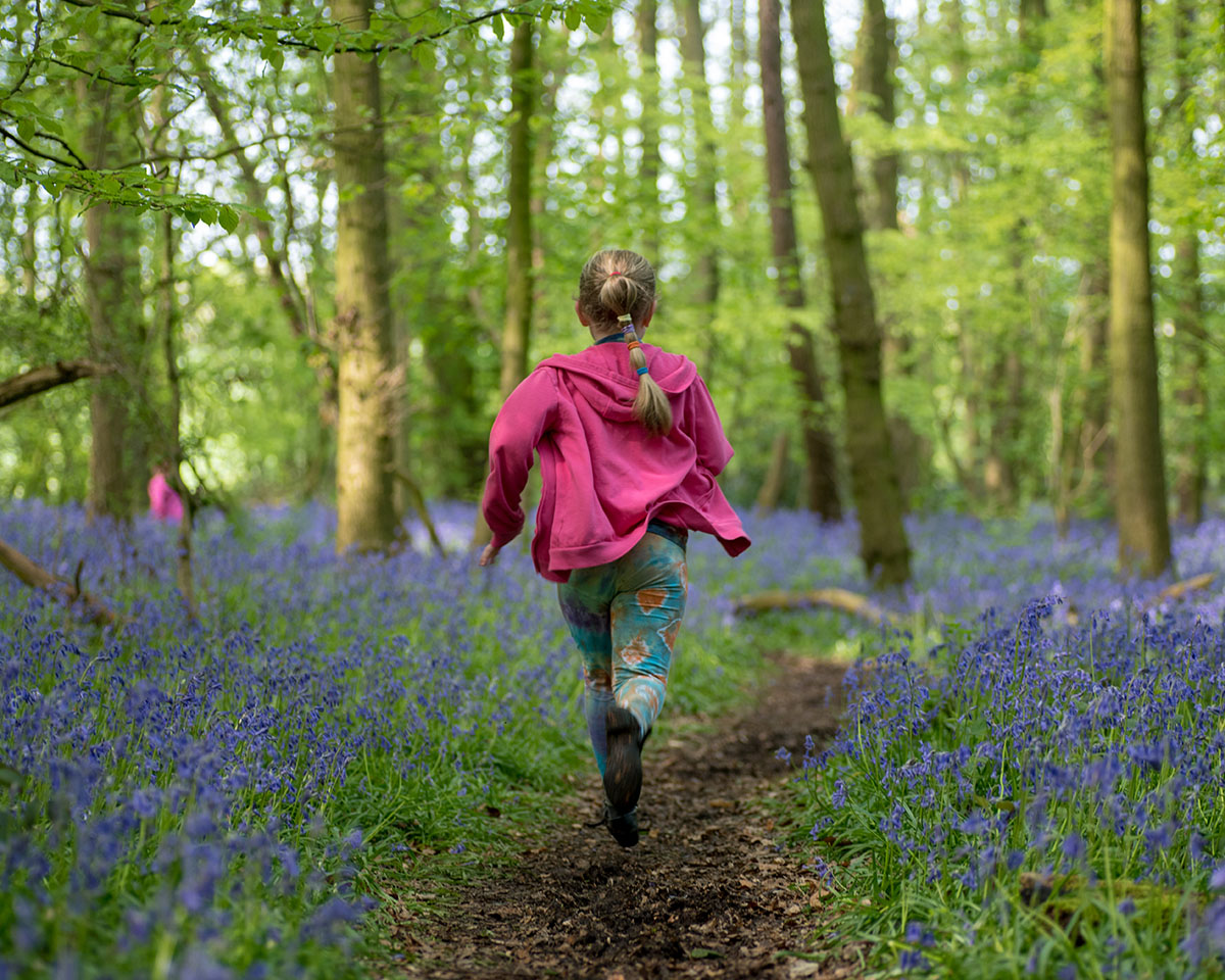 This young lady certainly enjoyed running wild through these bluebells this spring