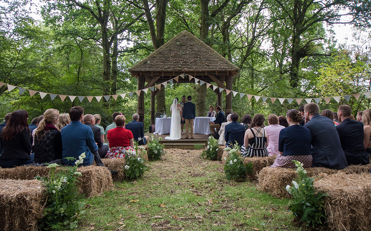 Laura and Ashley got married under this beautiful wooden pergola in the idyllic clearing outside Pitt Hall Barn, Hampshire.