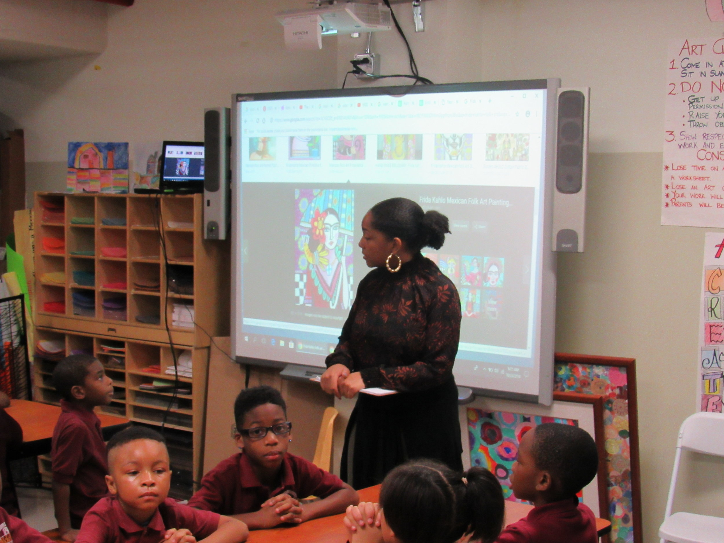 Ms. Gautier in the art room teaching our scholars.