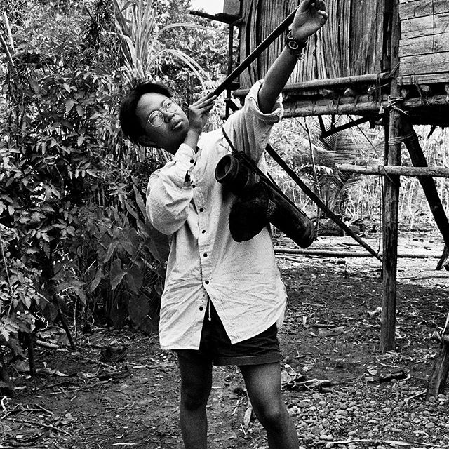 Posing with blowpipe. This is from my travels to a remote part of the Indonesian #jungle to visit the hunter-gather tribe the Wana.  This was shot on black and white film in the pre-digital age.  Lugging cameras in the rainforest not fun.  https://www.thendobetter.com/blog/2019/8/1/wana-tribe-visit  #travel #travelphotography #35mm #film  #composition #focus #capture  #photography  #photo #travelgram  #bwphotography #bwphoto #photography  #bnw #streetphotography #nofilter #35mmphotography