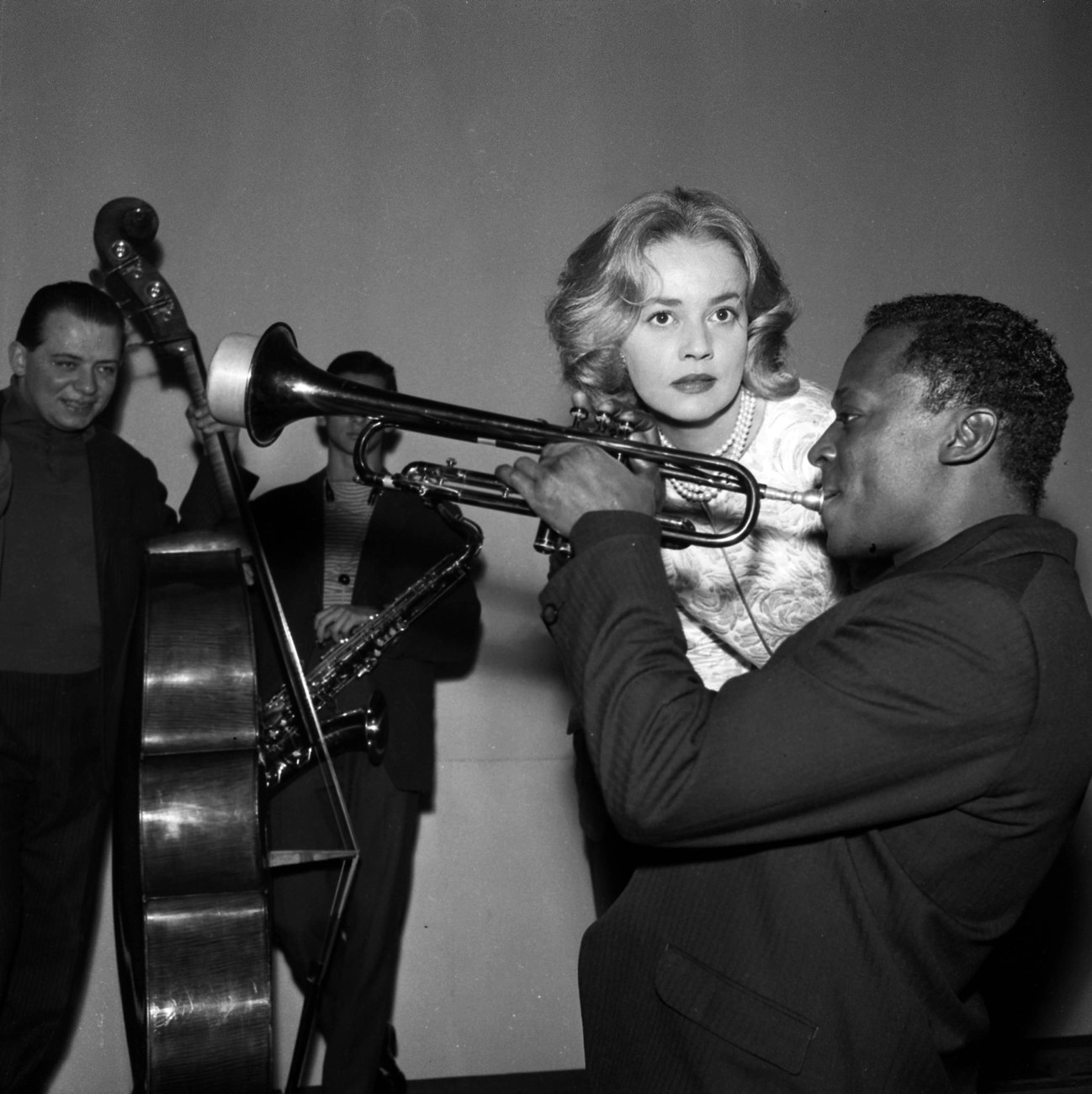 """Jeanne Moreau and Miles Davis during the recording of the music for Louis Malle's film """"Elevator to the Gallows,"""" in December, 1957."""
