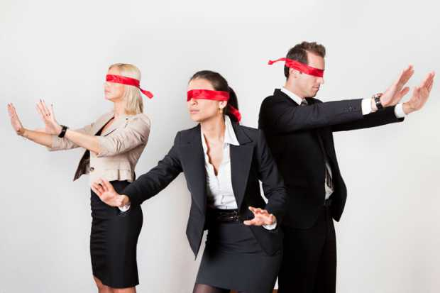 blindfolded-business-people-holding-arms-out.jpg
