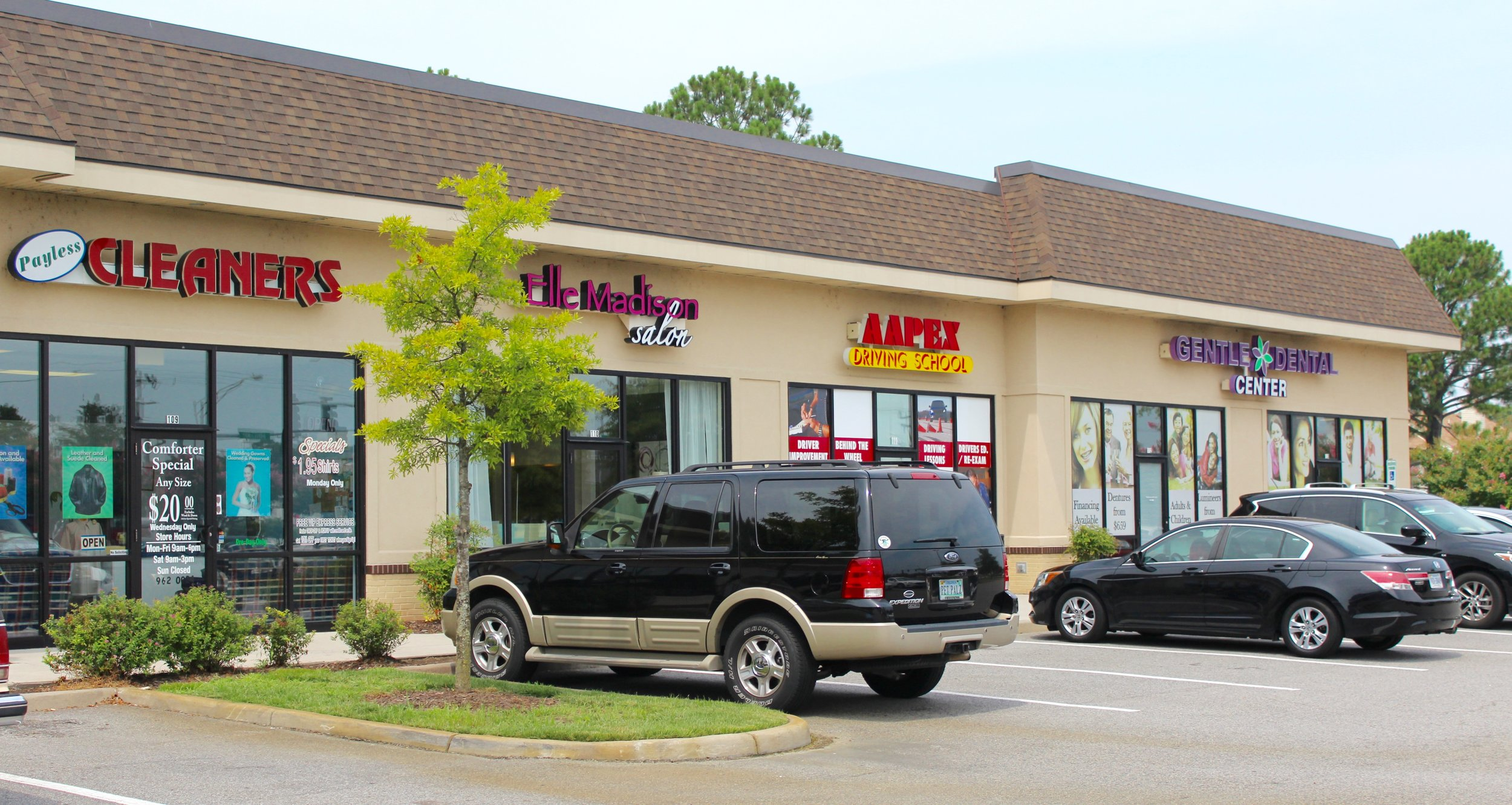 Located in Auburn Place Shoppes on Holland Road.  Across from Tread Quarters & Little Caesar's.