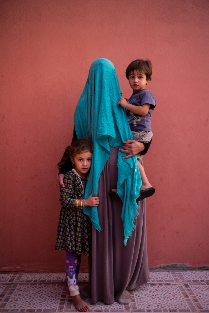 Photo courtesy Nicole Tung  Suad was forcibly married to an ISIS fighter. She escaped with her two children but her husband is one of the many Yazidis missing. Many Yazidi women cover their face in pictures for fear of being recognized.