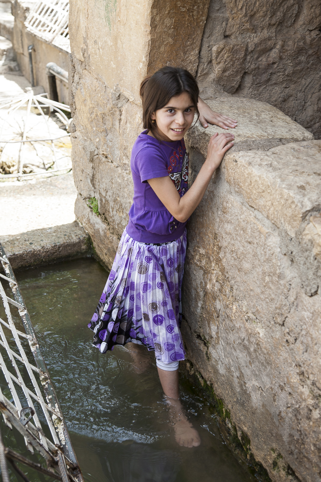 A carefree young Yazidi at the holy site of Lalish before the Genocide that brutalized so many lives.  Photo credit: Saverio Serravezza