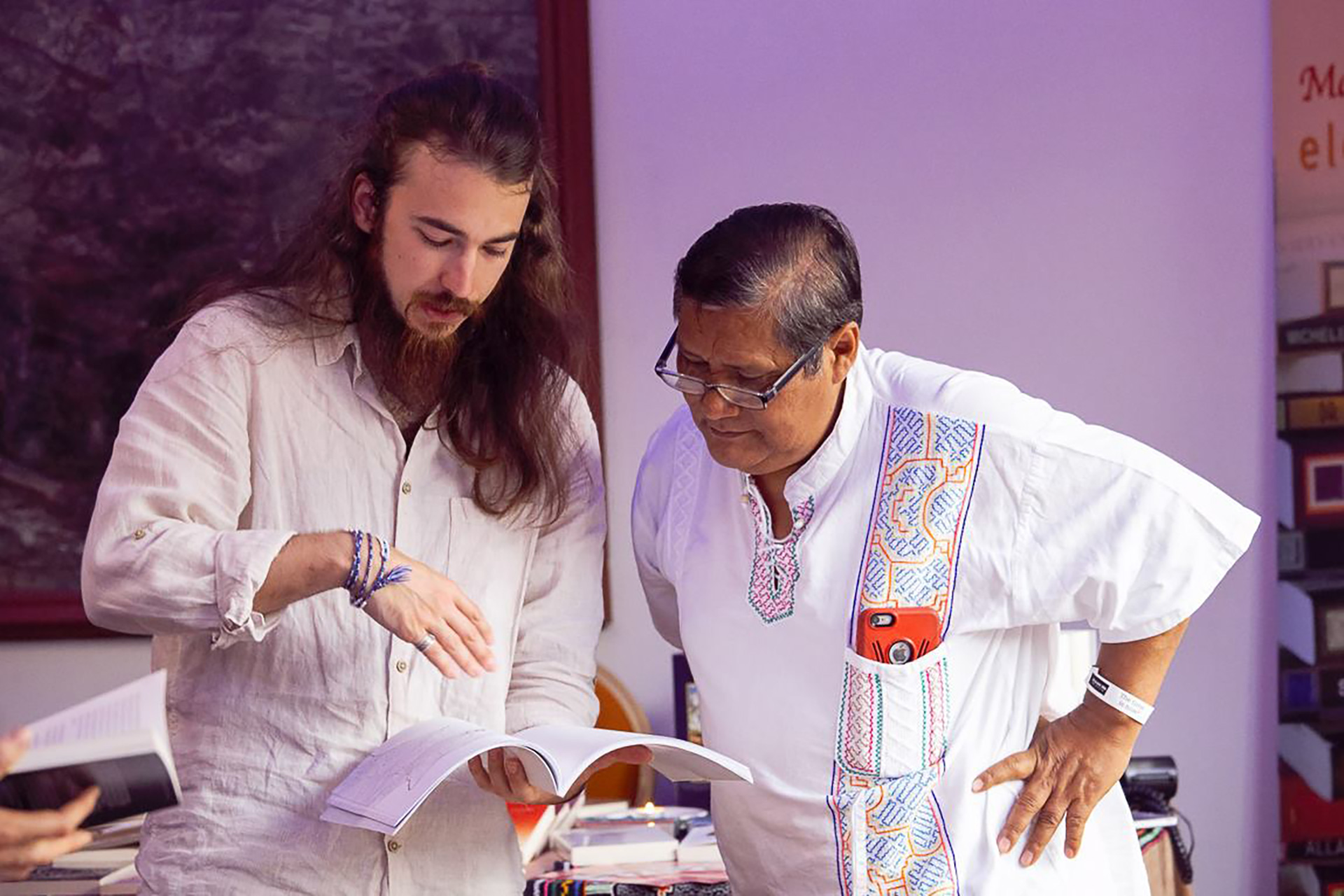 Myself with world-renowned Shaman, Don José Campos. Showing him my Ayahuasca coloring book.