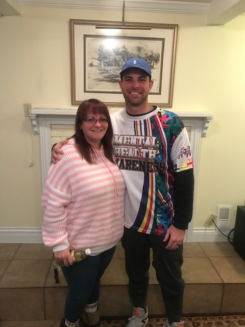 Brandy and Gavin - Gavin wearing the commemorative Softball Jersey for mental health awareness.