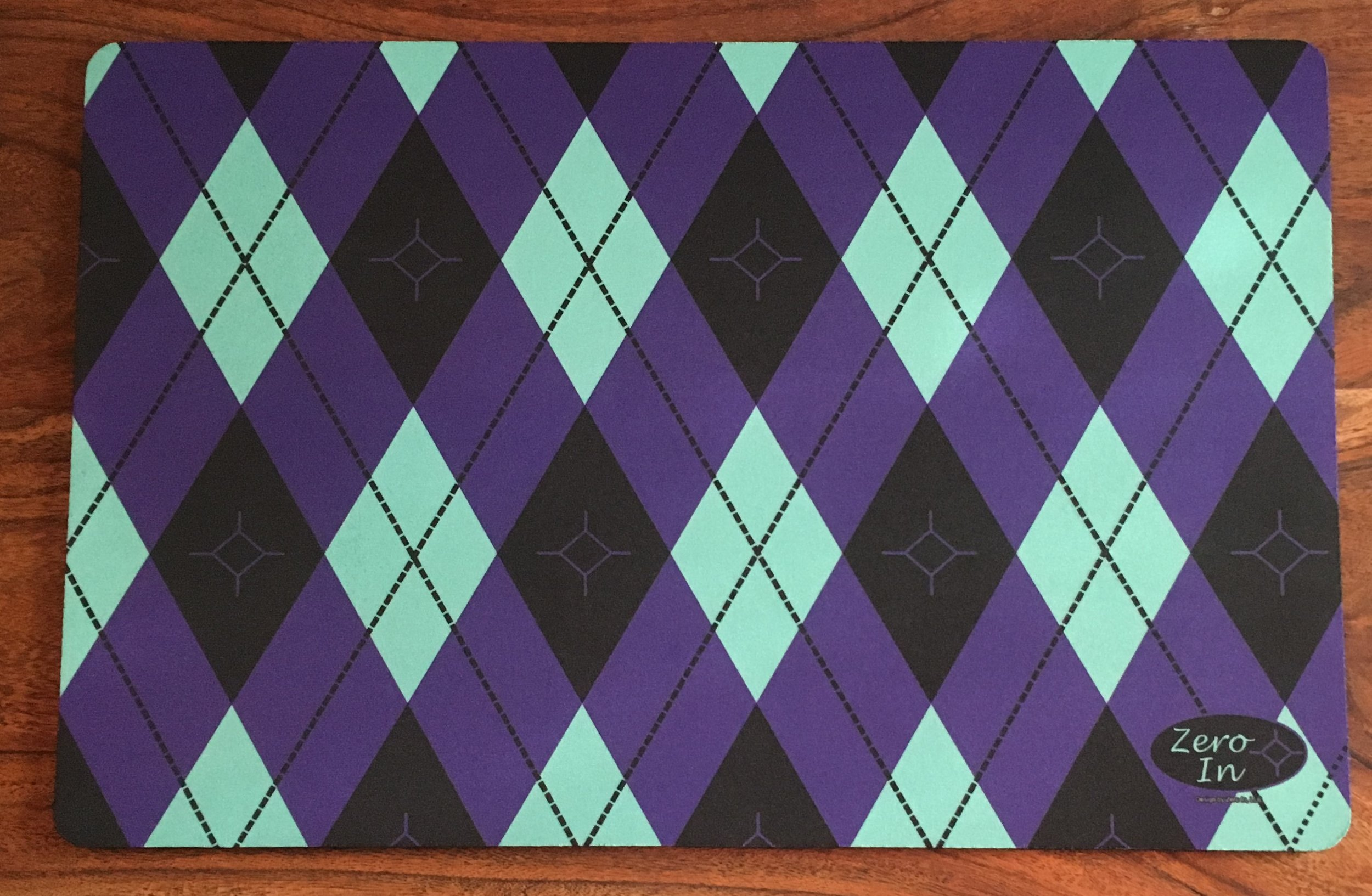 Signature Argyle - We utilized our flagship colors of Deep Lavender and Light Aqua Green, then dotted it with the Zero In diamond.  This is the first design that started it all (and our favorite!)