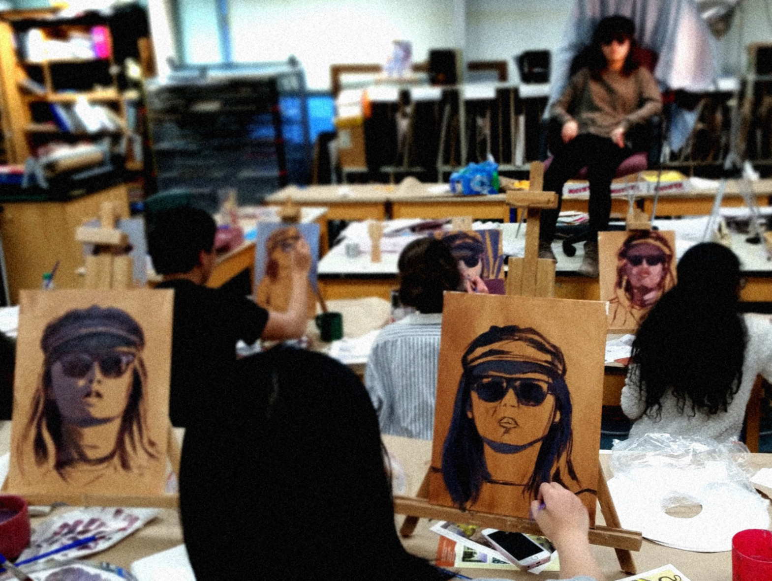 Students participating in a four hour studio workshop in the early stages of a costumed portrait.