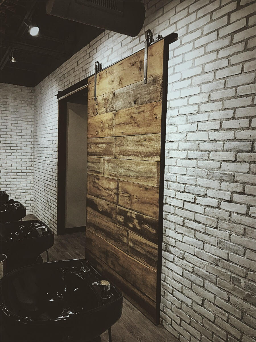 ViVo Salon - This sliding door was a custom project made from reclaimed barn wood. The rustic accent piece is located in Vivo Salon in Springfield, MO, and was featured in the June 2017 issue of 417 Magazine.