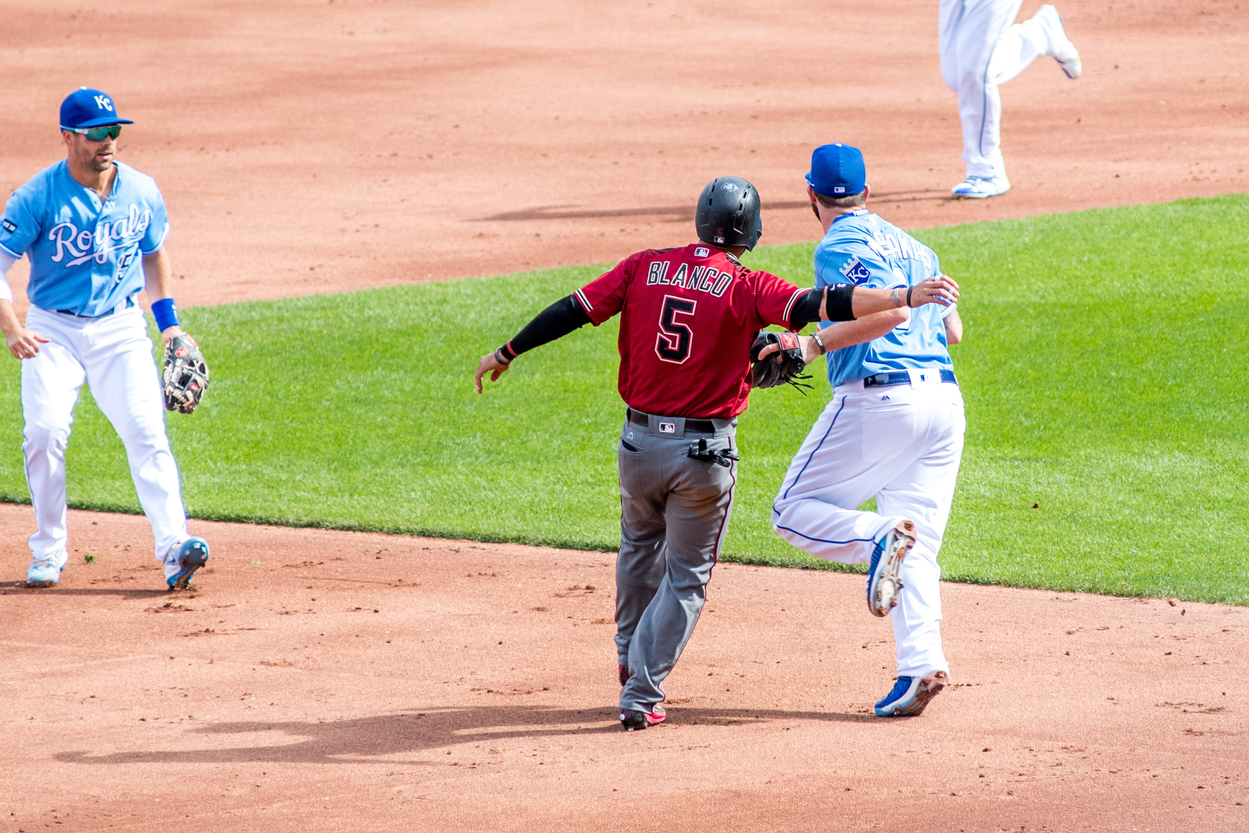 The end of the pickle was Mike Moustakas tagging out the Diamondbacks runner. One of the things that made the Royals so much fun to watch the last few years was their commitment to defense. The images in this series are a great way to remember that!