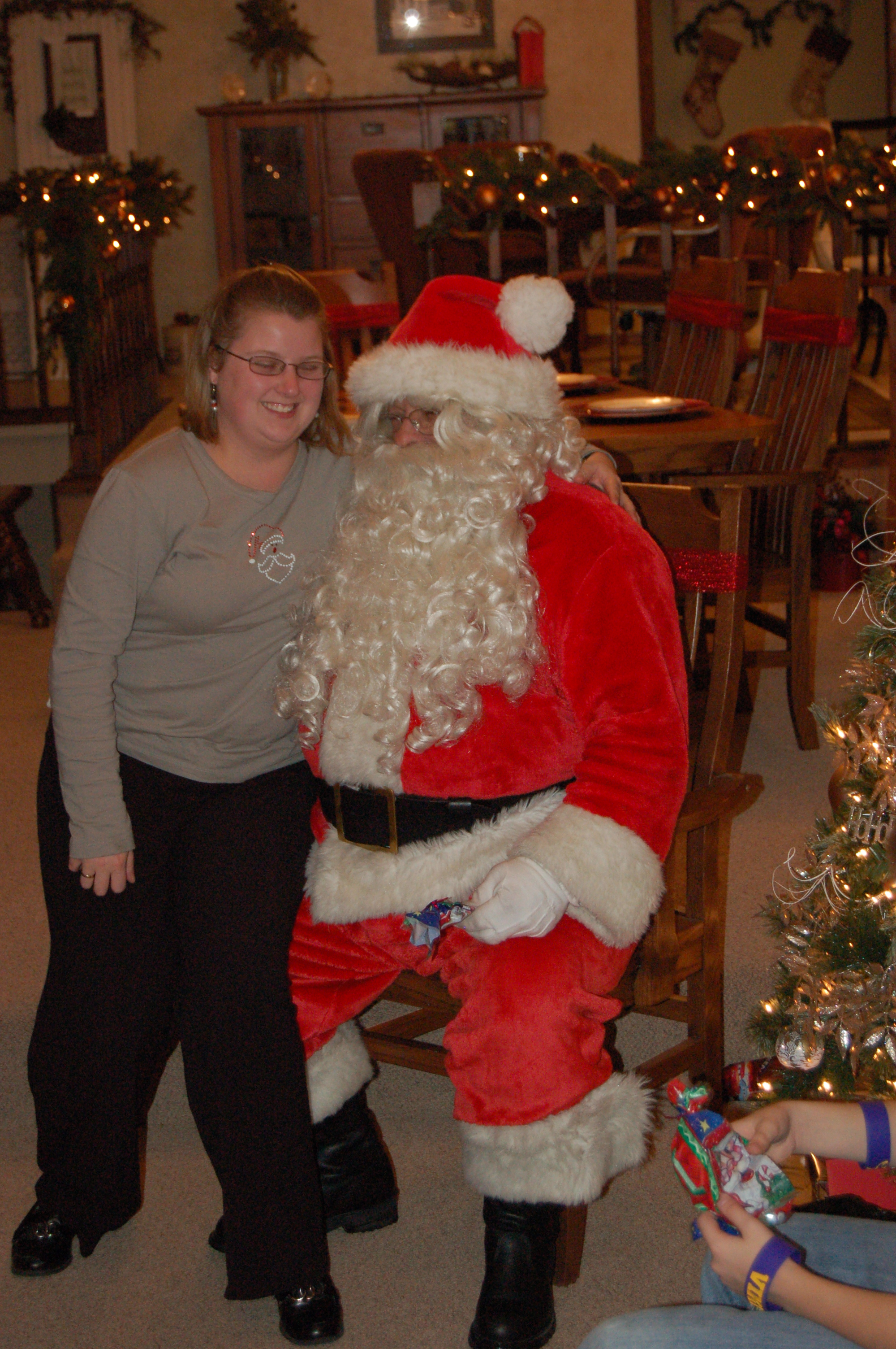 I love that Sandy will put up with the silly things my family does. Including making everyone (even adults) sit on Santa's lap at Christmas time.