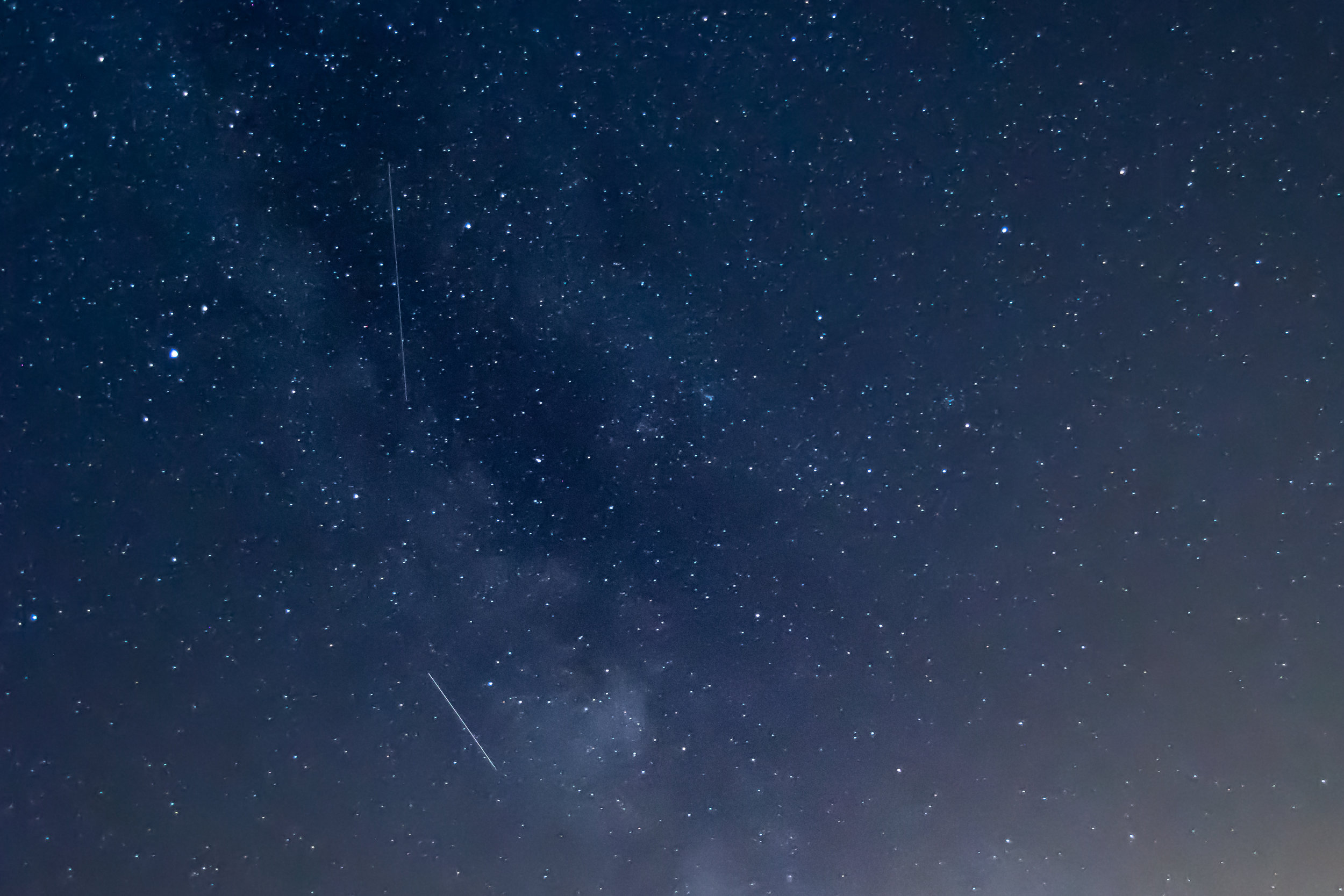 After pointing the camera a little higher in the sky to avoid light pollution, I was lucky enough to capture two Perseid Meteors in front of the Milky Way!!!