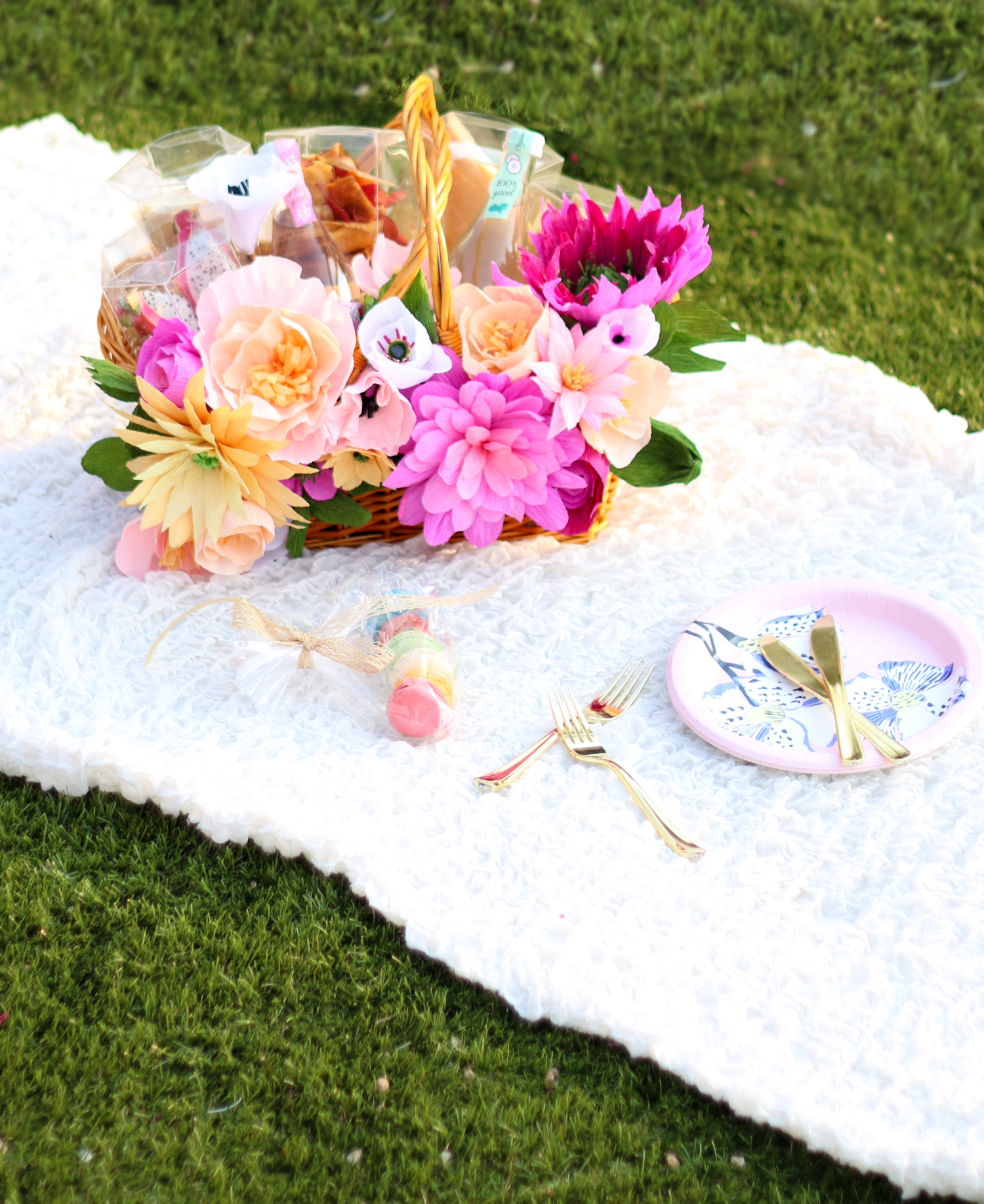 Picnic basket paper flowers table centre.jpg