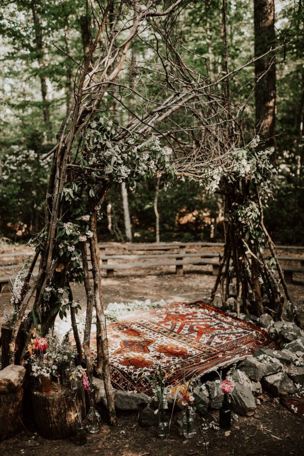 A stunning wedding tipi from branches and greenery found on  June Bug Weddings .