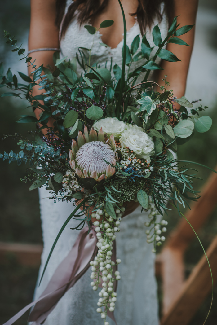 Stunning succlent wedding bouquet featured on  June Bug Weddings.