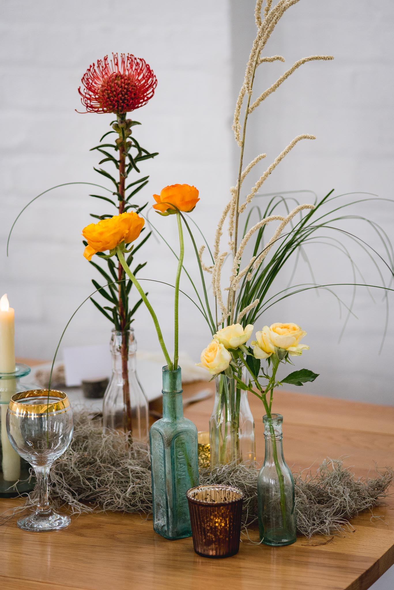 Simple boho wedding flowers in vintage jars as seen in our blog post for a  southwestern styled shoot