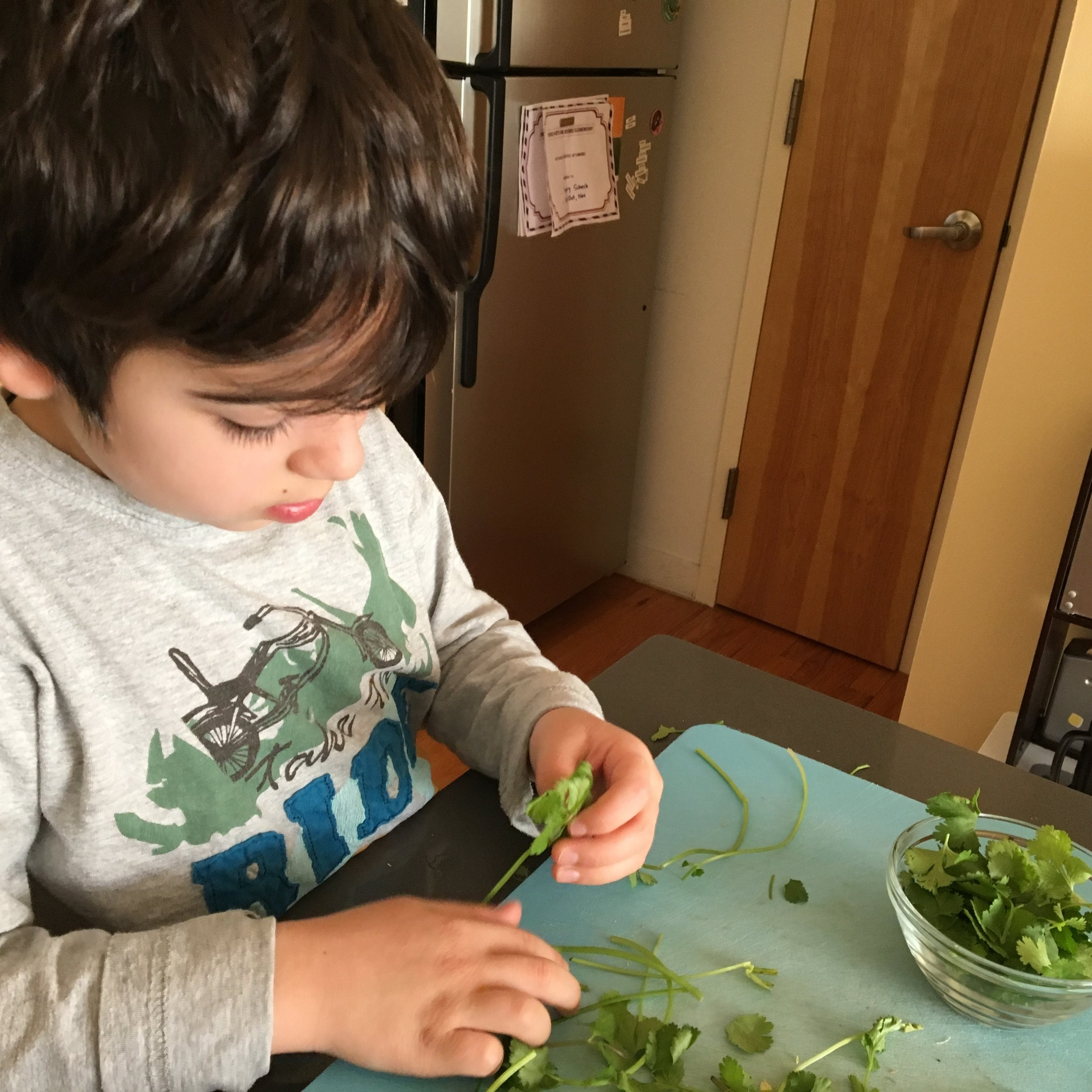 Pluck Herbs - Let's face it, you don't have time to pull the herb leaves from their stems and so in a hurry, you often find yourself using the stems even though you know you probably shouldn't. Let your kids take the leaves from the stems and set them aside. Kids can help you make a pesto or prepare a garnish. Or they can simple get the leaves ready for use in a recipe you're making tomorrow. They will likely eat a few along the way and that's great news. #eatyourgreens