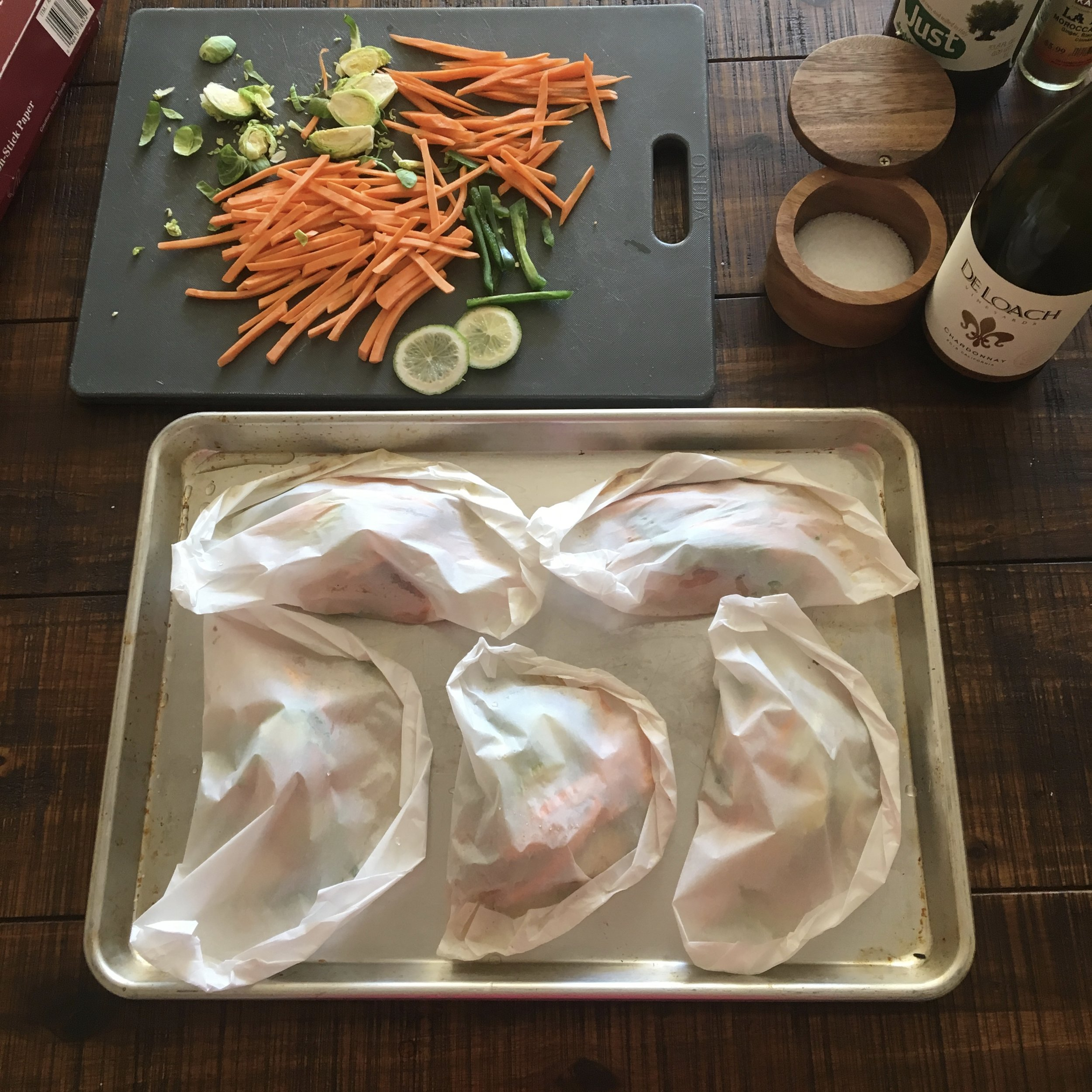 10. Arrange papillotes in a single layer on a baking sheet and bake for approximately 15 minutes, more or less for larger/denser or smaller/lighter pieces of fish.