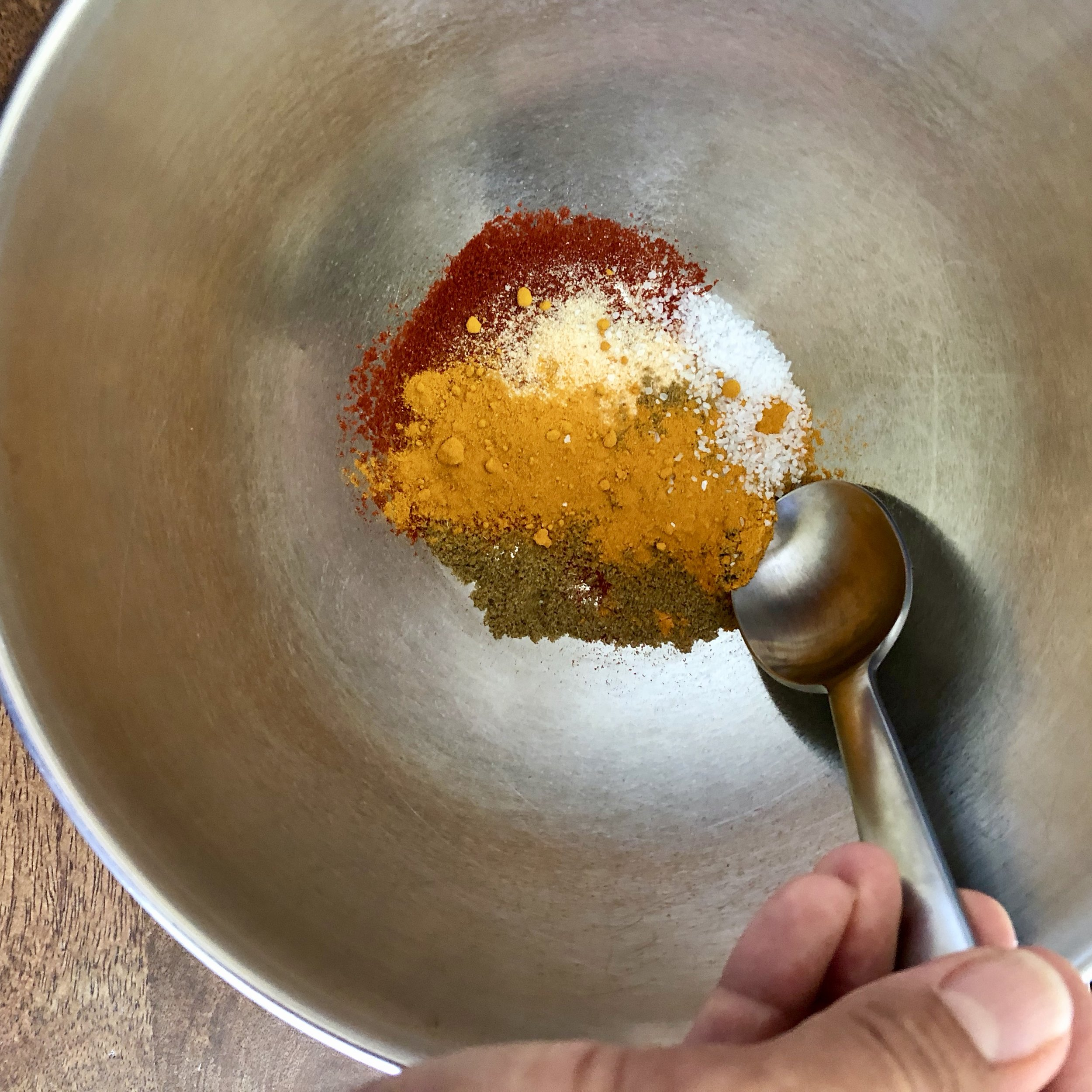 Step 2: - In a bowl, mix together your selected spices.